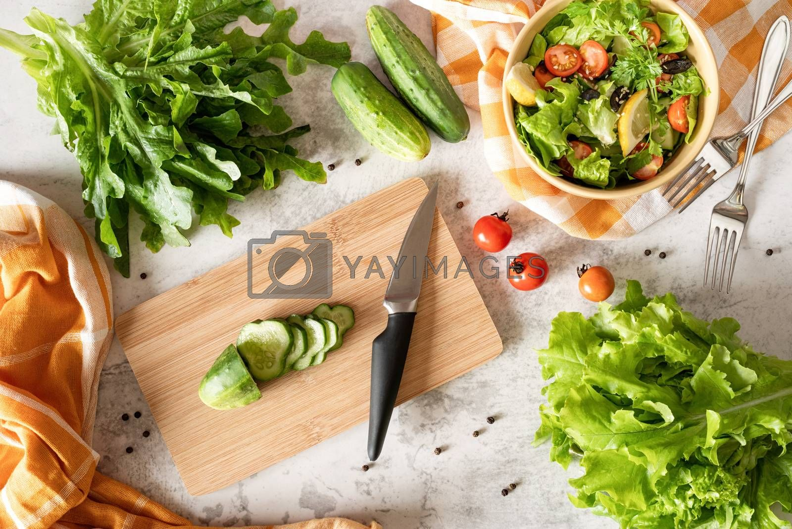 Royalty free image of Top view of making vegetable salad from organic vegetables by Desperada