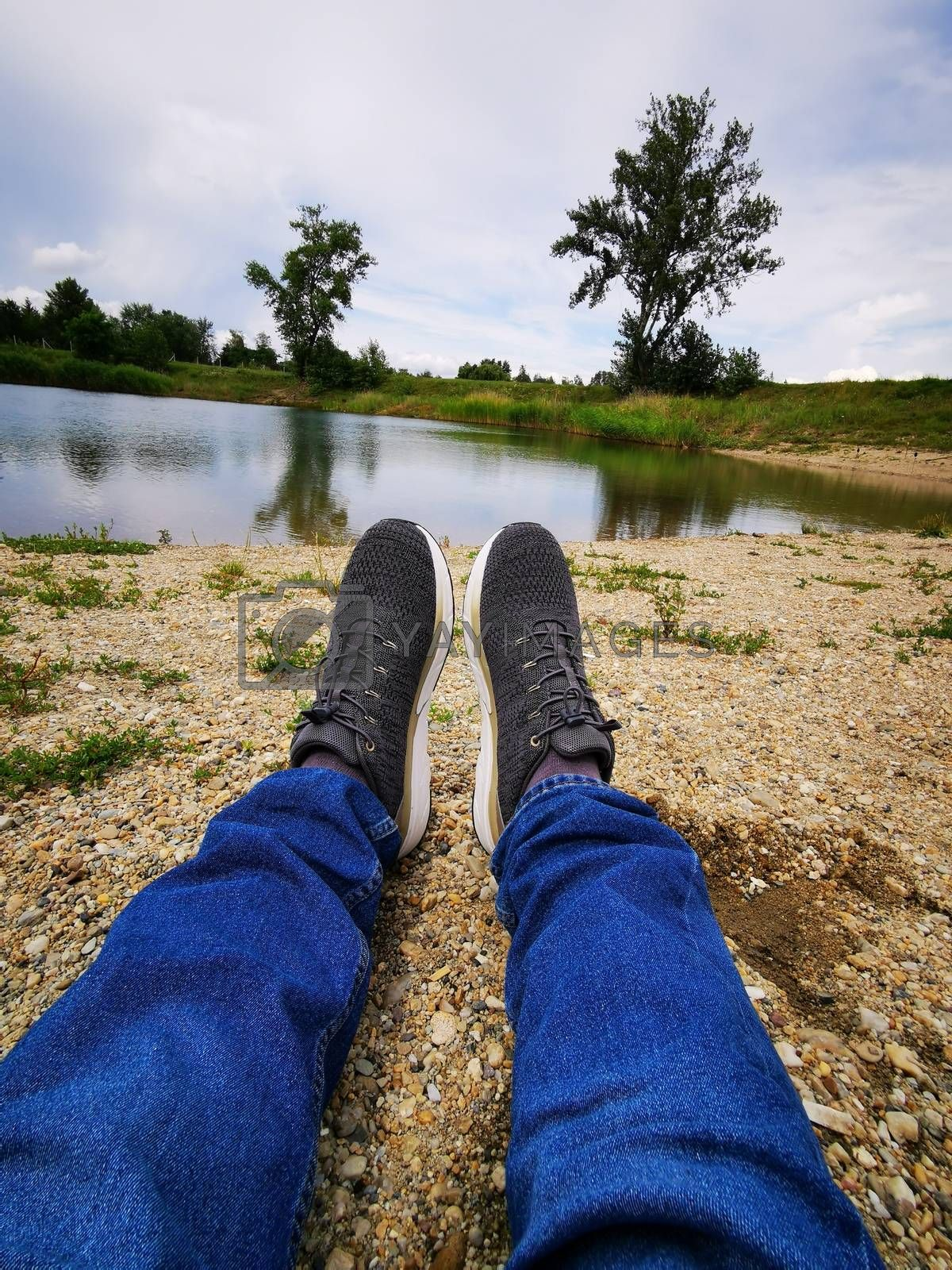 Royalty free image of The person who lies at the lake of Mály  by balage941
