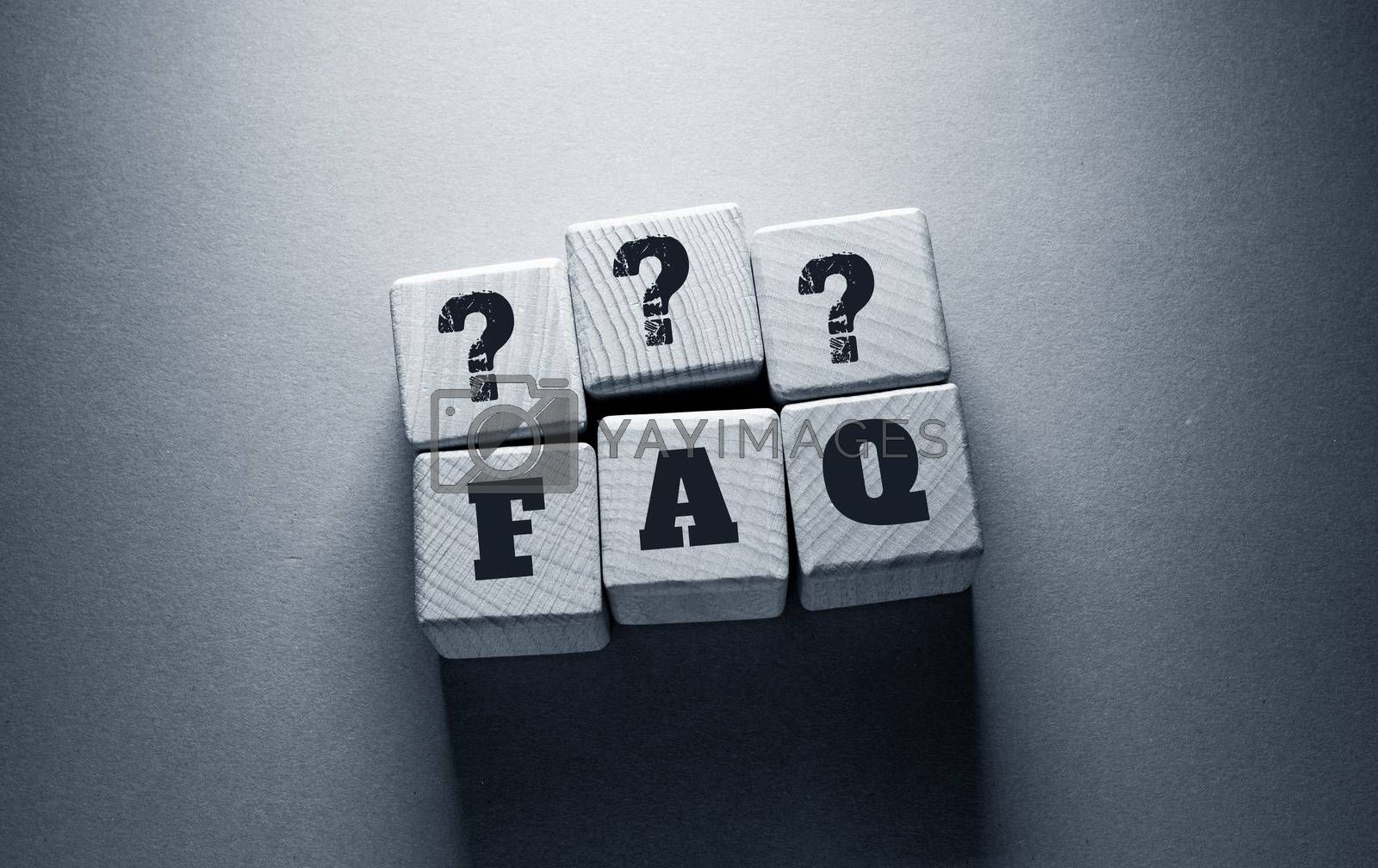Royalty free image of FAQ Word with Wooden Cubes by Jievani
