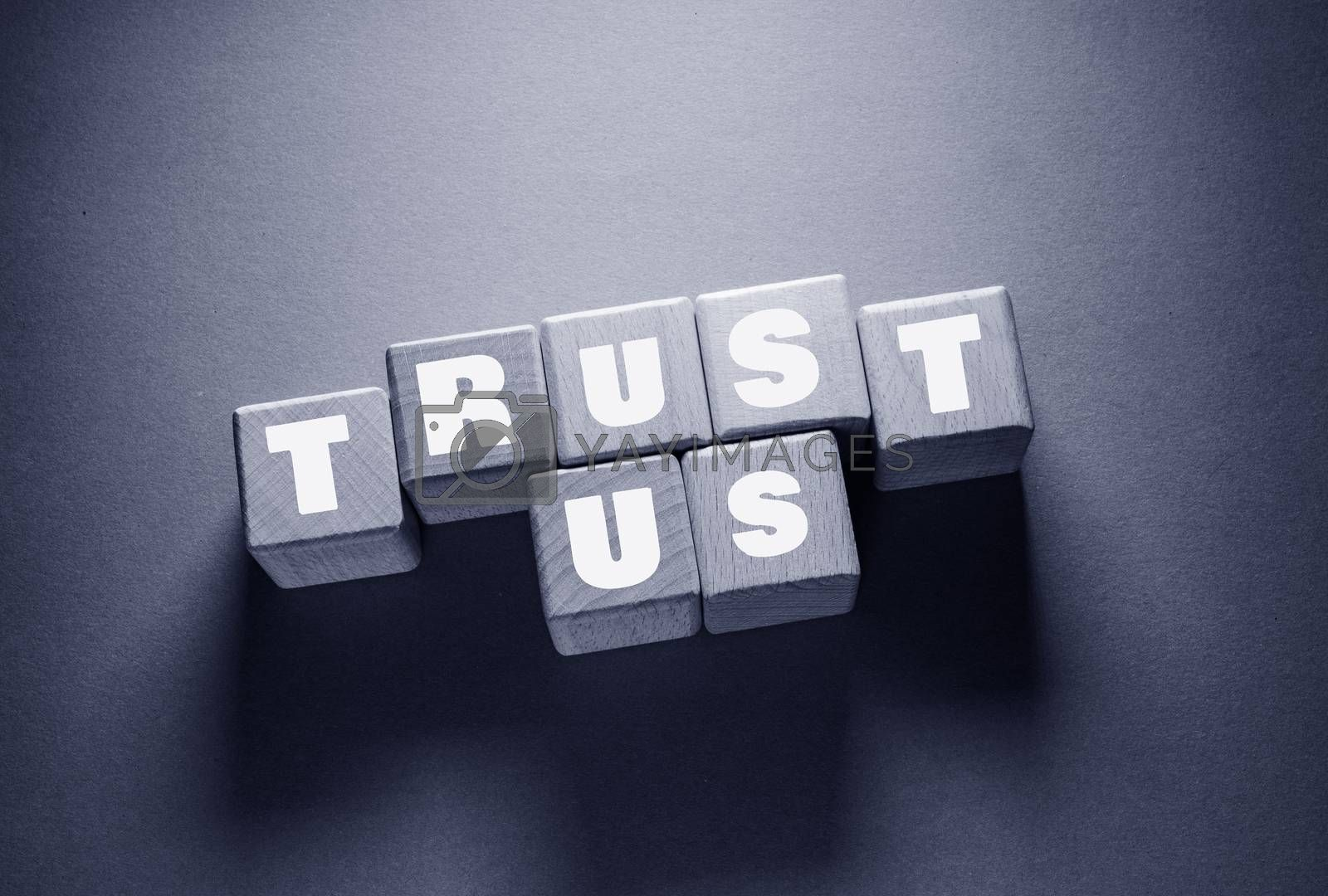 Royalty free image of Trust Word with Wooden Cubes by Jievani