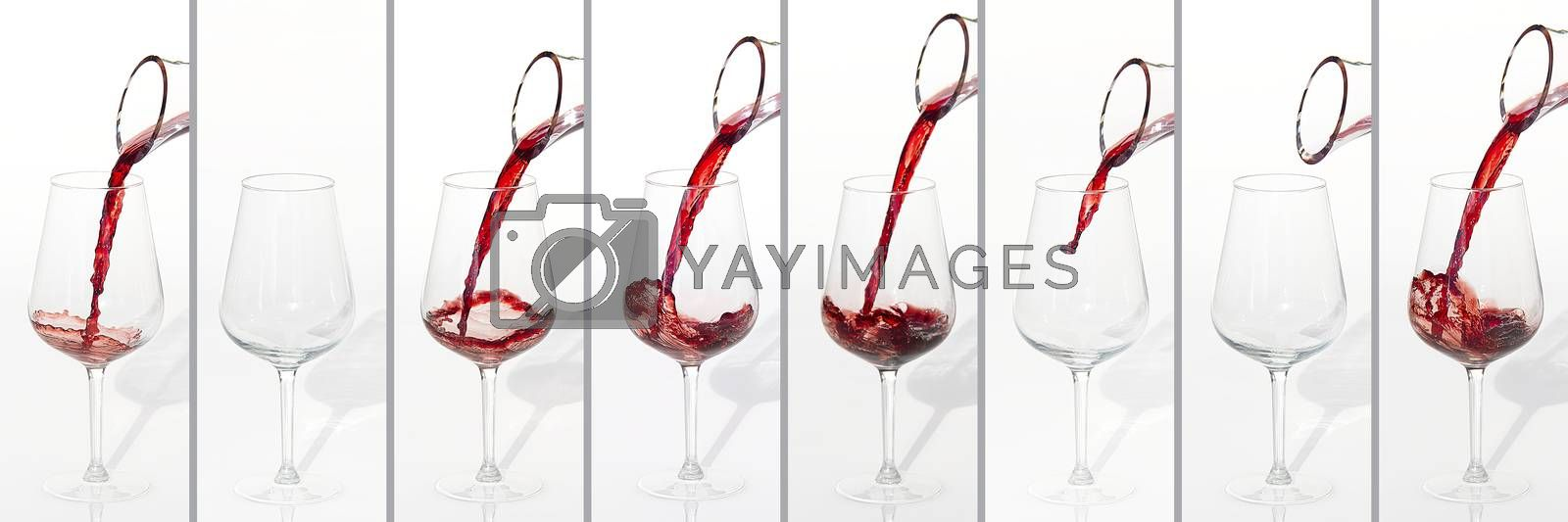 Royalty free image of Sommelier pours red wine from decanter to wineglass on white background. panoramic shoot or banner. collage by PhotoTime