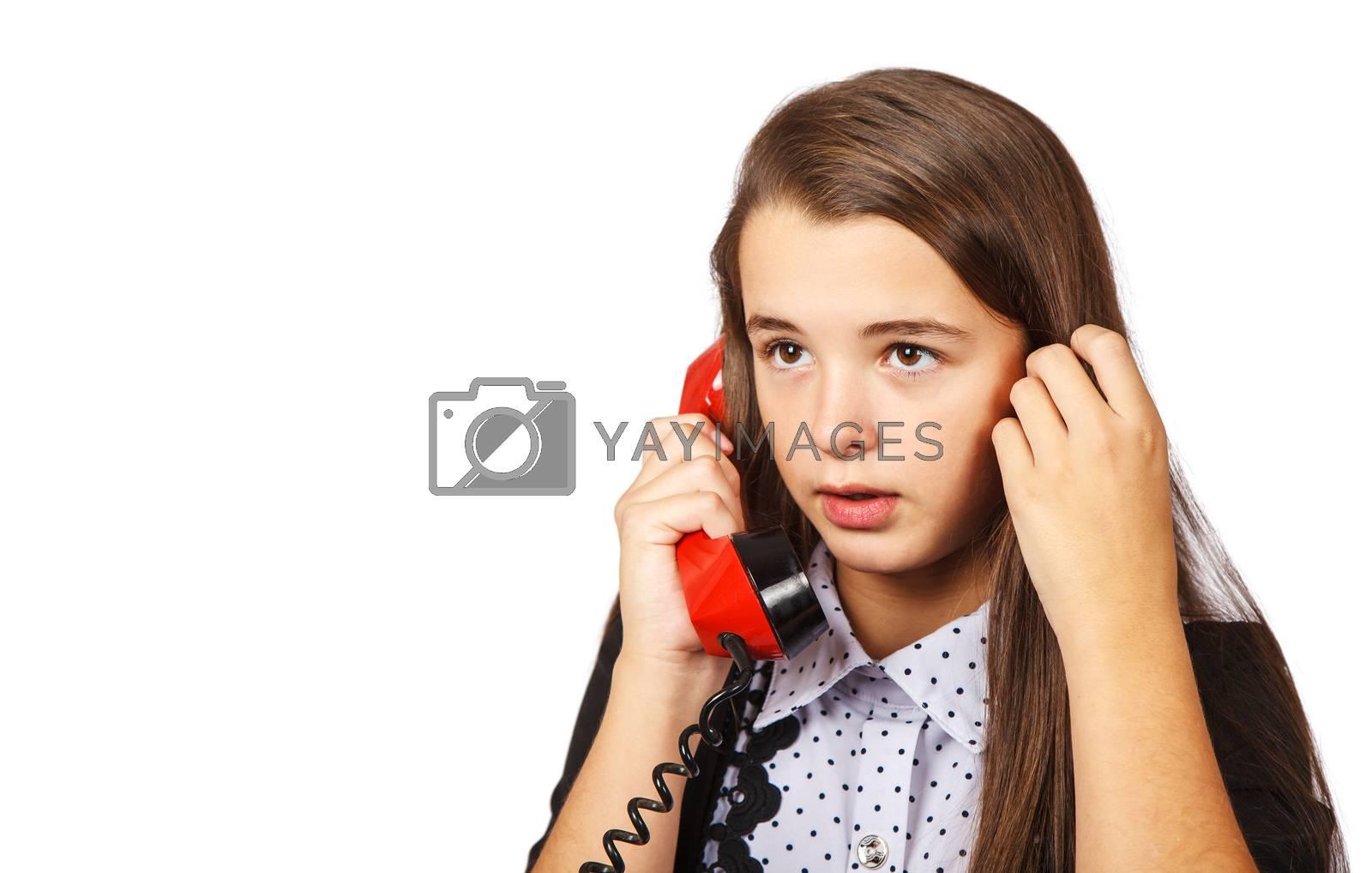 teenage brunette girl talking on red retro telephone closeup on white background