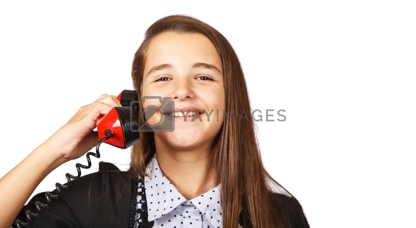 teenage brunette smiling girl talking on red retro telephone closeup on white background