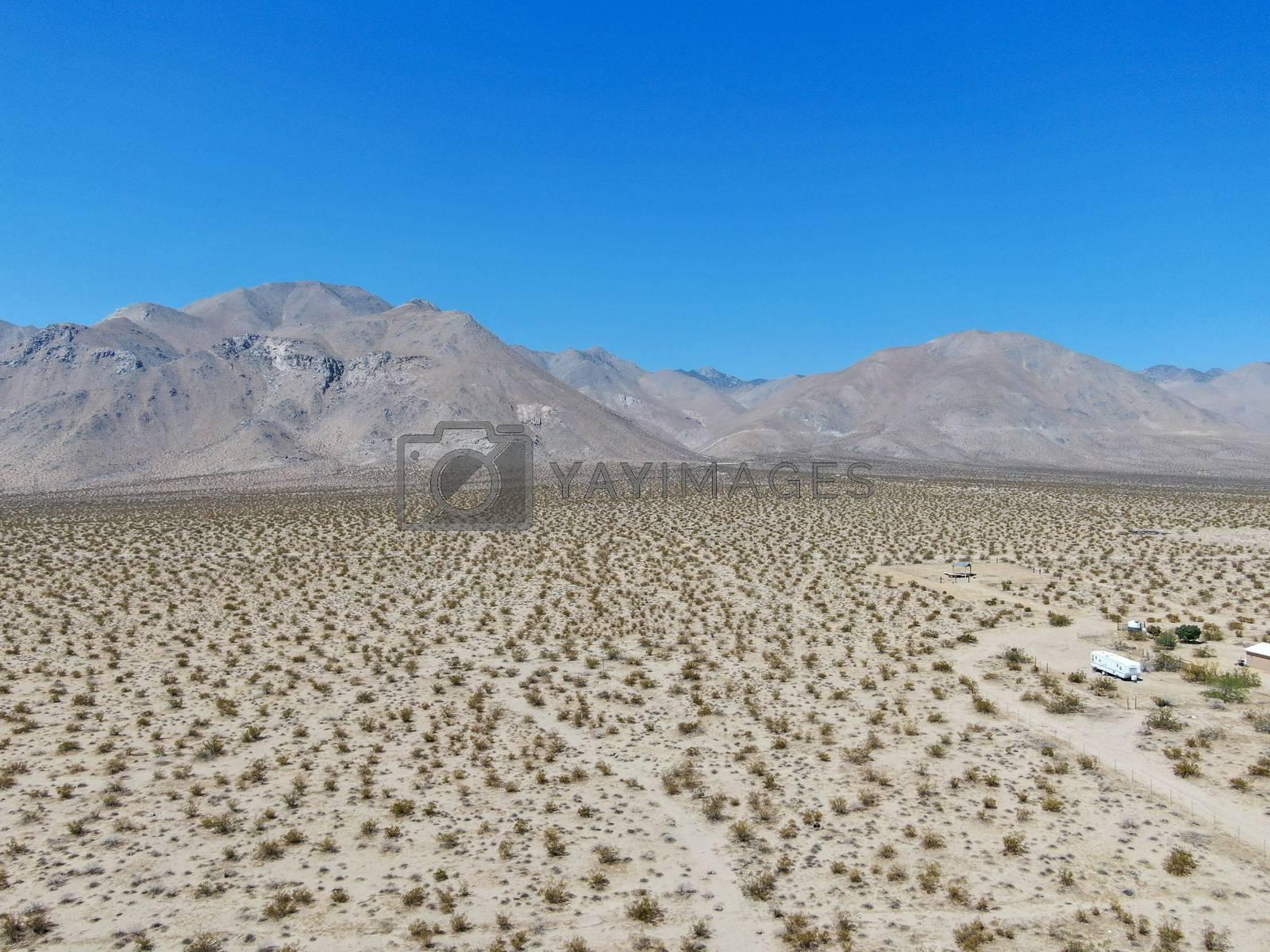 Aerial view of desert hills under blue sky in California's Mojave desert, near Ridgecrest.  by Bonandbon