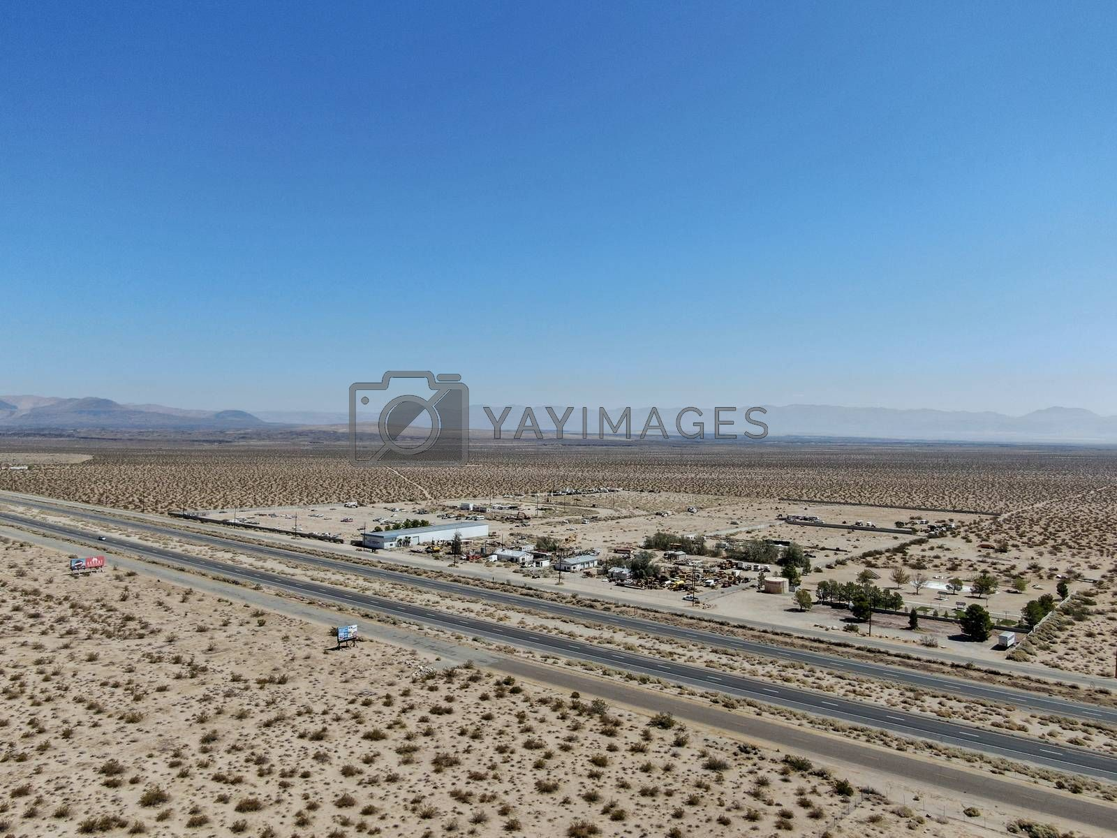 Royalty free image of Aerial view of road in the middle of the desert under blue sky in California's Mojave desert, near Ridgecrest.  by Bonandbon