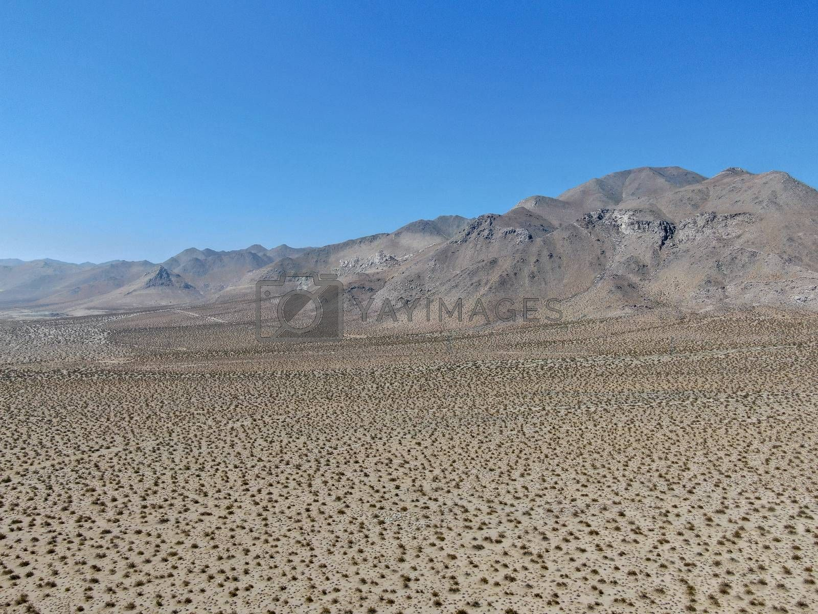 Royalty free image of Aerial view of desert hills under blue sky in California's Mojave desert, near Ridgecrest.  by Bonandbon
