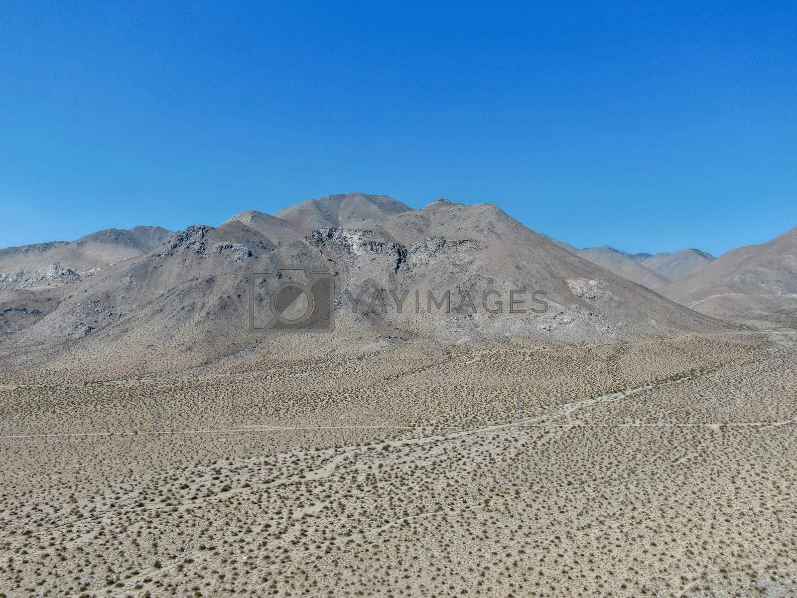 Aerial view of desert hills under blue sky in California's Mojave desert, near Ridgecrest.  by Bonandbon