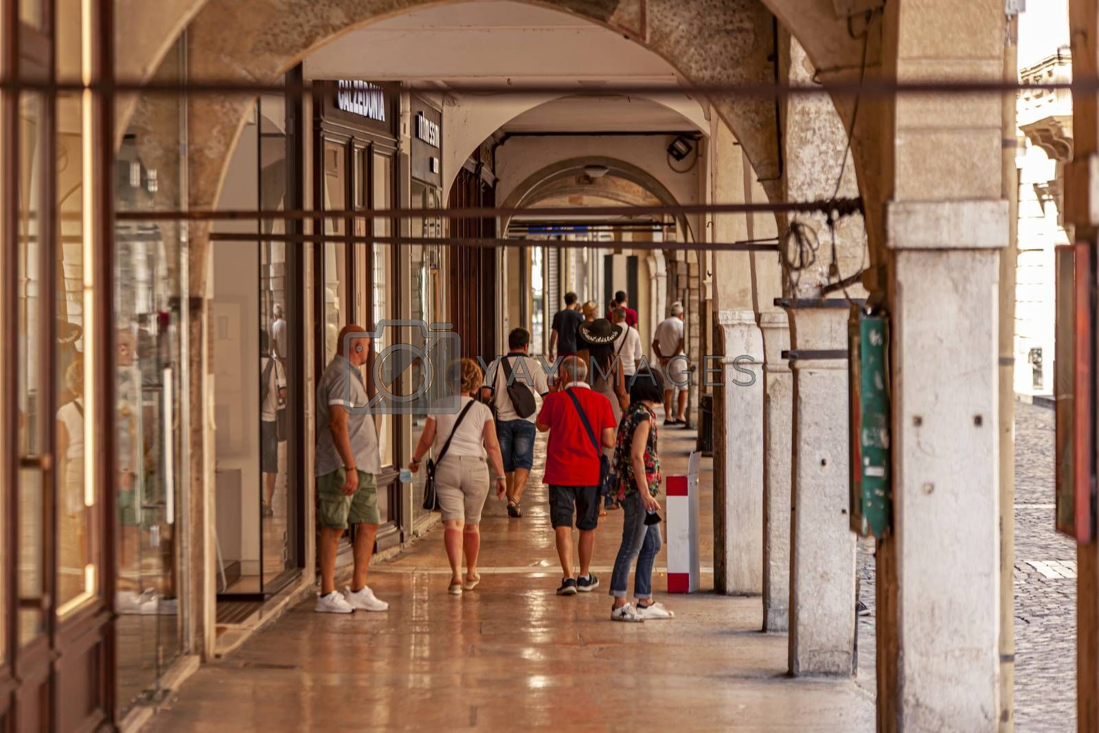 TREVISO, ITALY 13 AUGUST 2020: People walking on arcades in Treviso in Italy