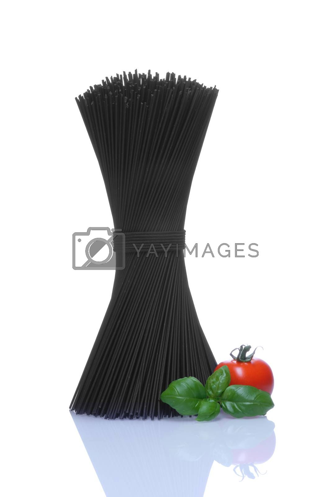 Black spaghetti with basel leaves and red tomato on white background.