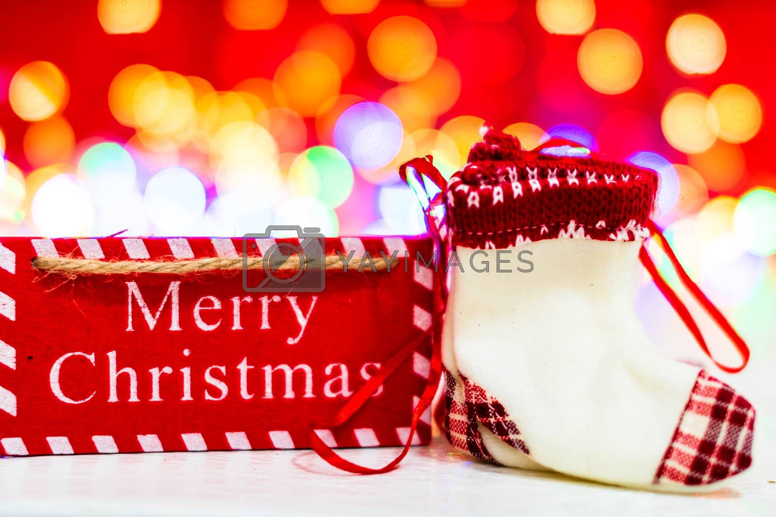Merry Christmas text wooden sign, decorations and ornaments in a colorful Christmas composition.