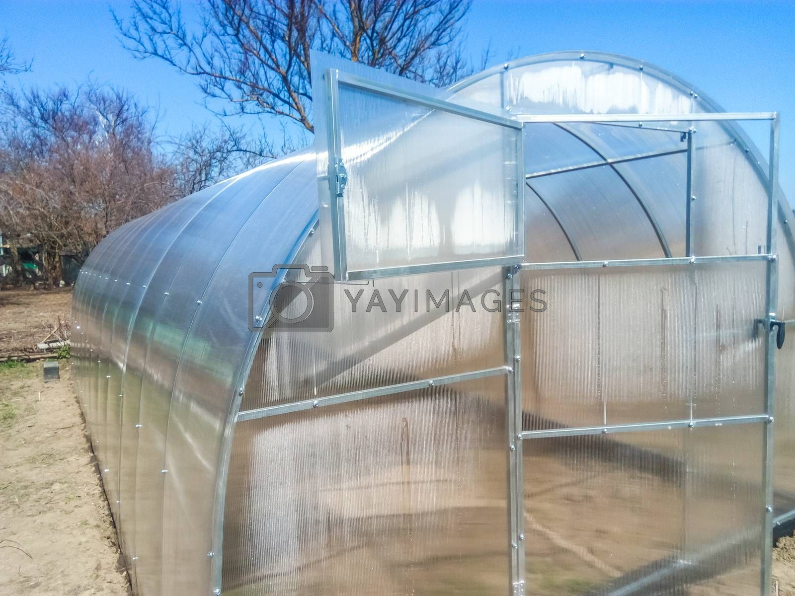 Greenhouse for vegetables. Polycarbonate greenhouse assembled from parts, prefabricated greenhouse.