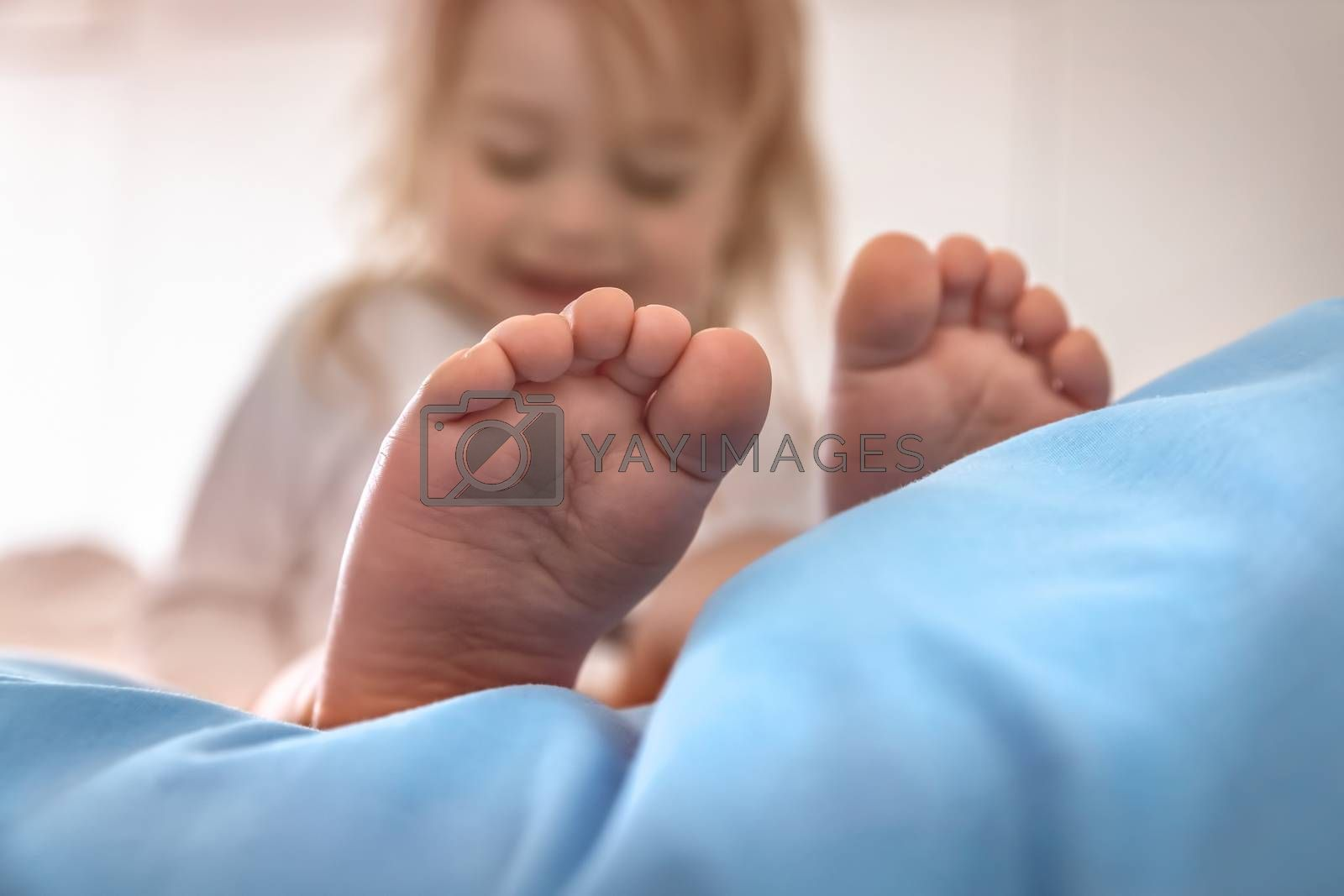 Selective Focus on a Cute Little Baby Boy's Bare Feet. Kid Enjoying Morning Time. Happy Healthy Child at Home