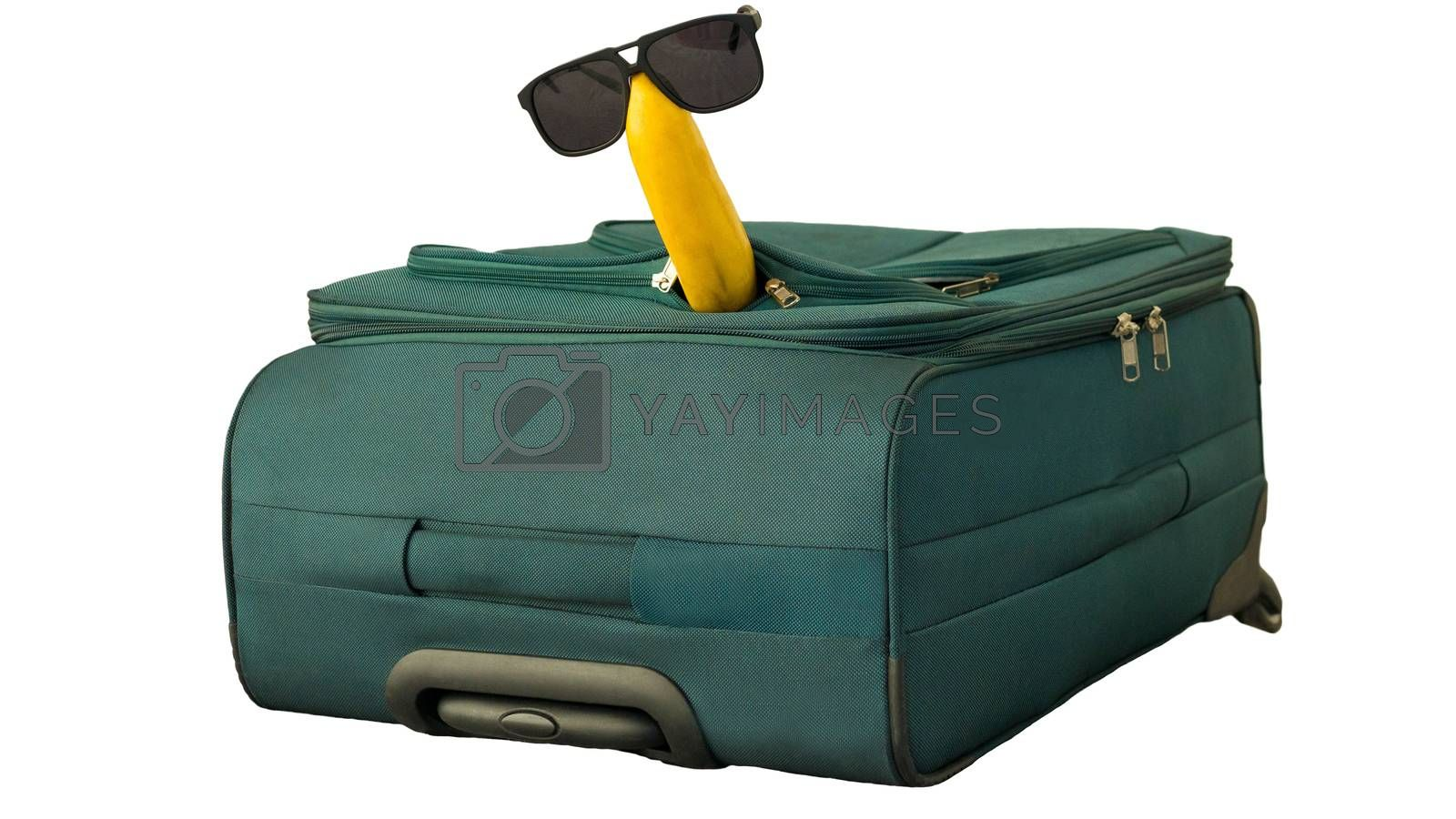 Royalty free image of Banana in sunglasses sits on a suitcase isolated on white,close-up. by Andriii_Klapkoo