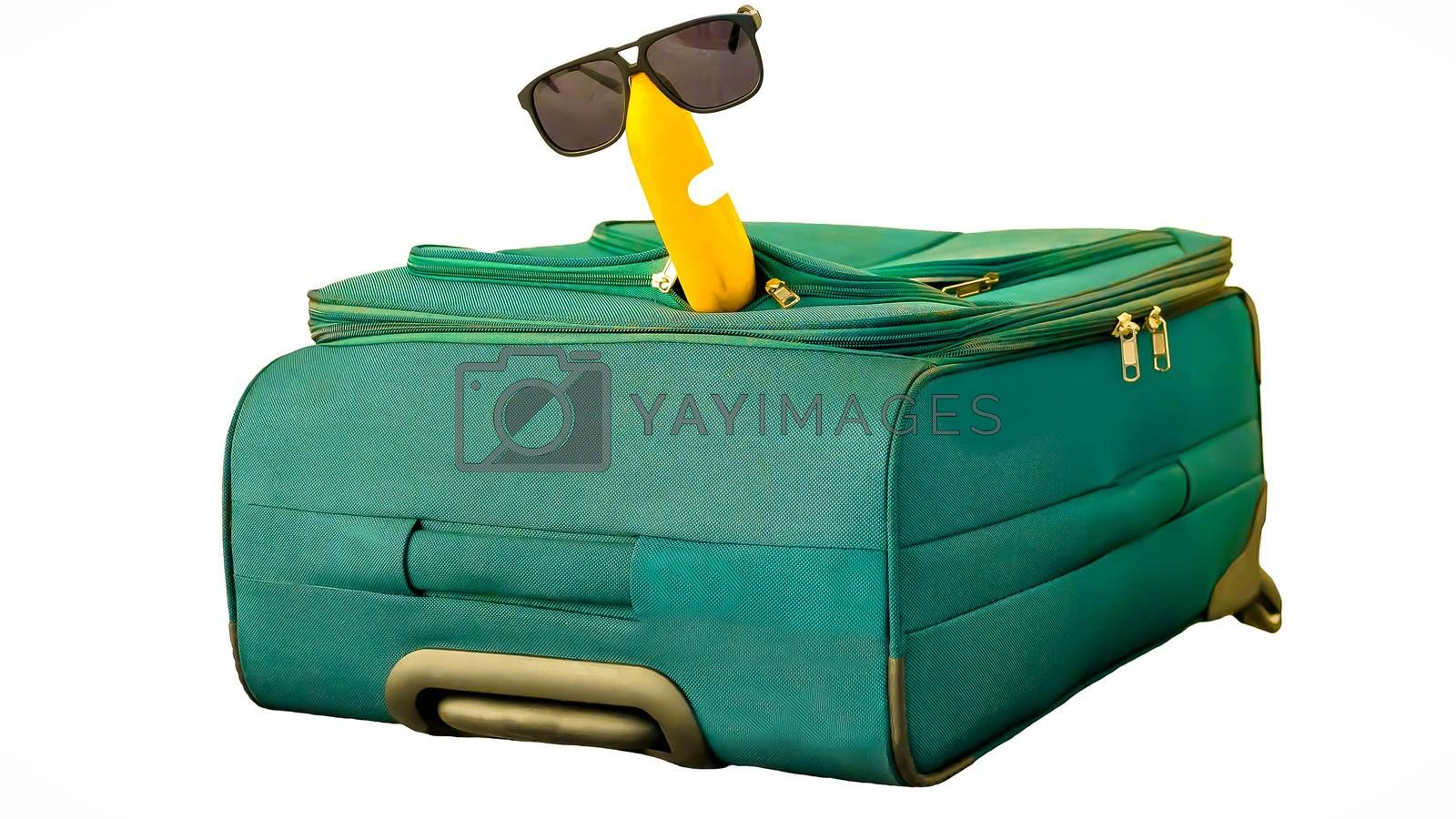 Royalty free image of Funny and cheerful banana in sunglasses with suitcase isolated on white background by Andriii_Klapkoo