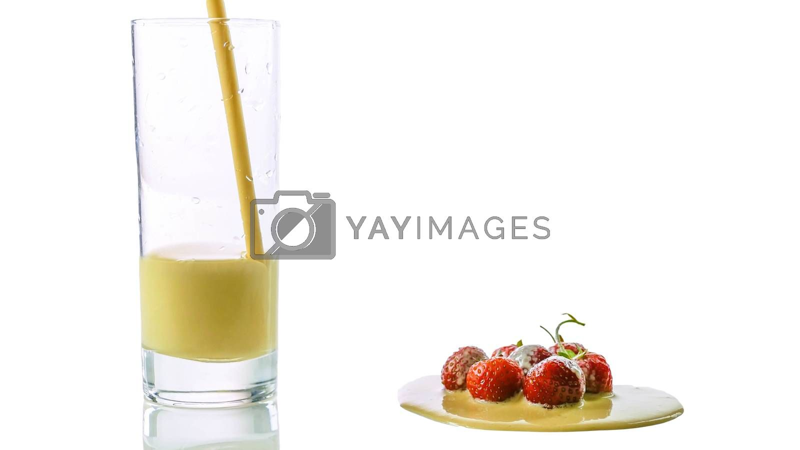 Royalty free image of Pour yogurt into a glass close-up,fresh strawberry with yogurt isolated on white. by Andriii_Klapkoo