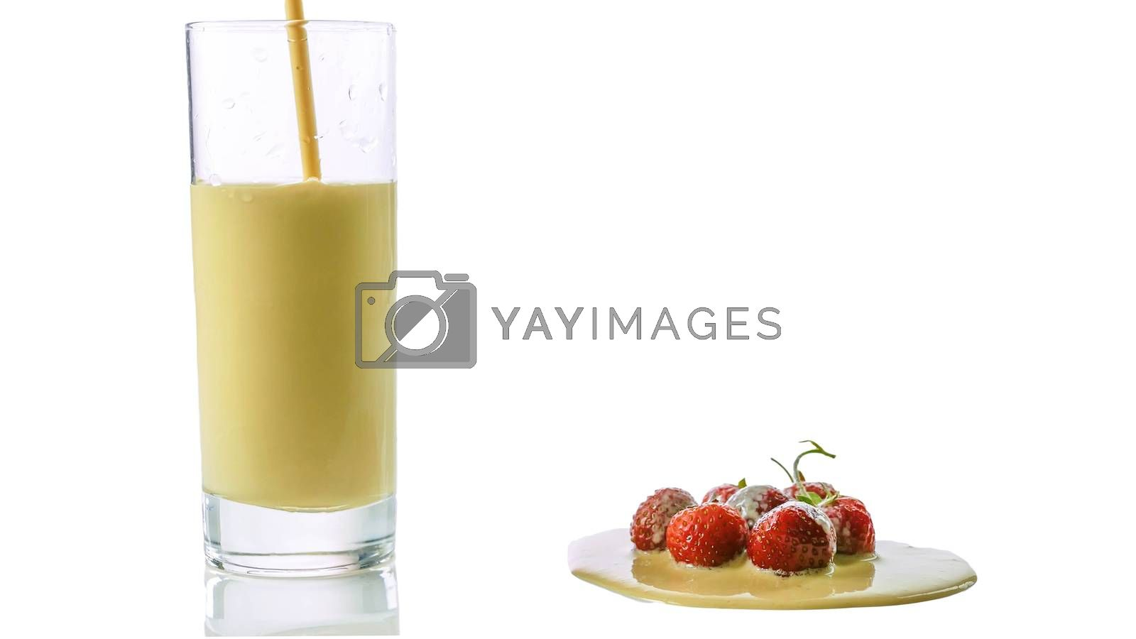 Royalty free image of Strawberry yogurt pouring into a glass isolated on white,fresh strawberry with milk drink.Closeup. by Andriii_Klapkoo