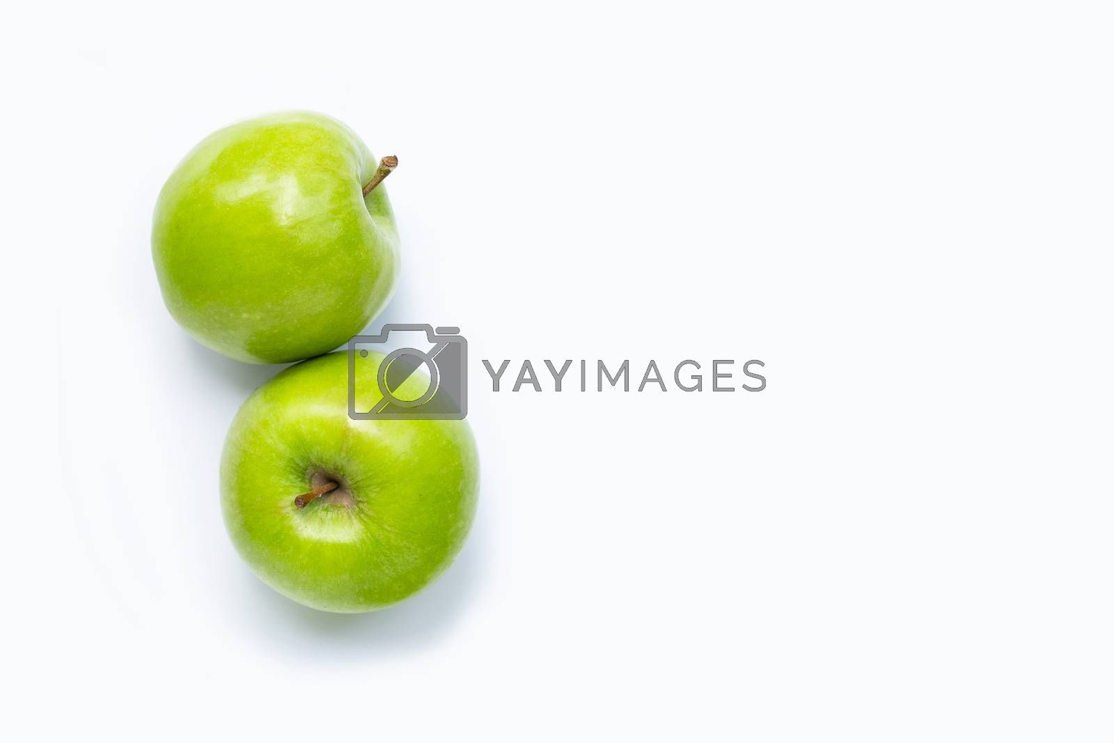 Green apples on white background. Copy space