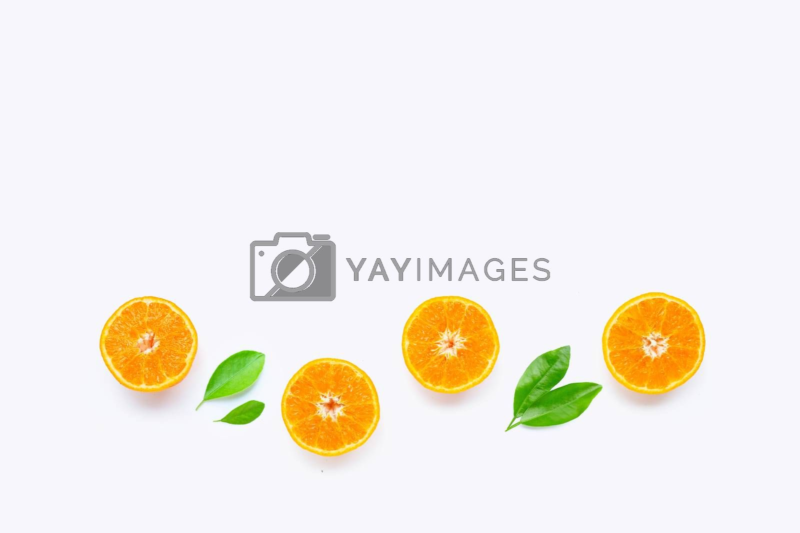 Fresh orange citrus fruit with leaves isolated on white background. Juicy and sweet and renowned for its concentration of vitamin C. Top view