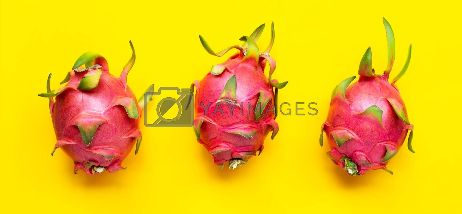 Dragon fruit or pitaya on yellow background. Top view