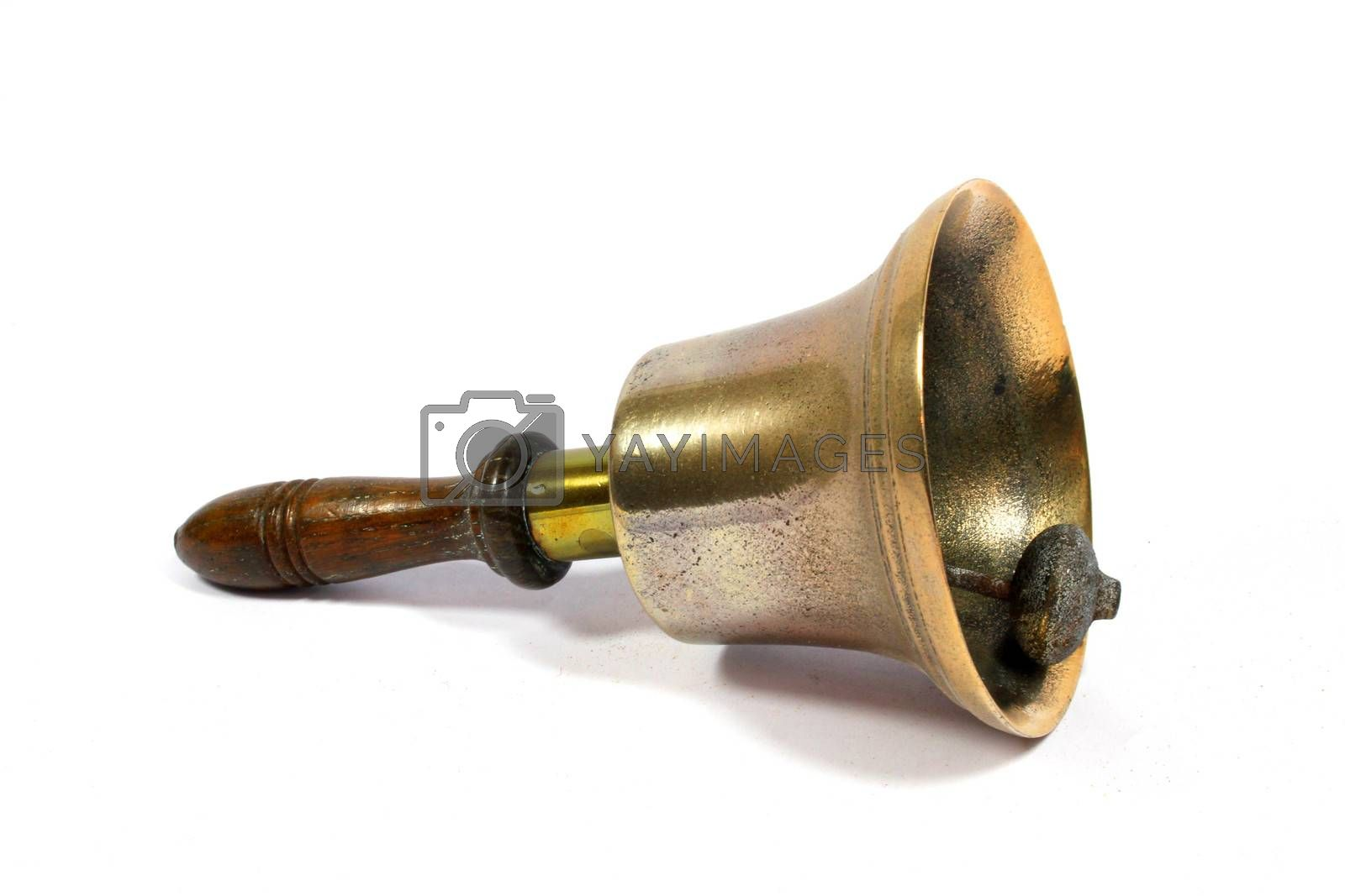 A Vintage Brass School Bell On White Background