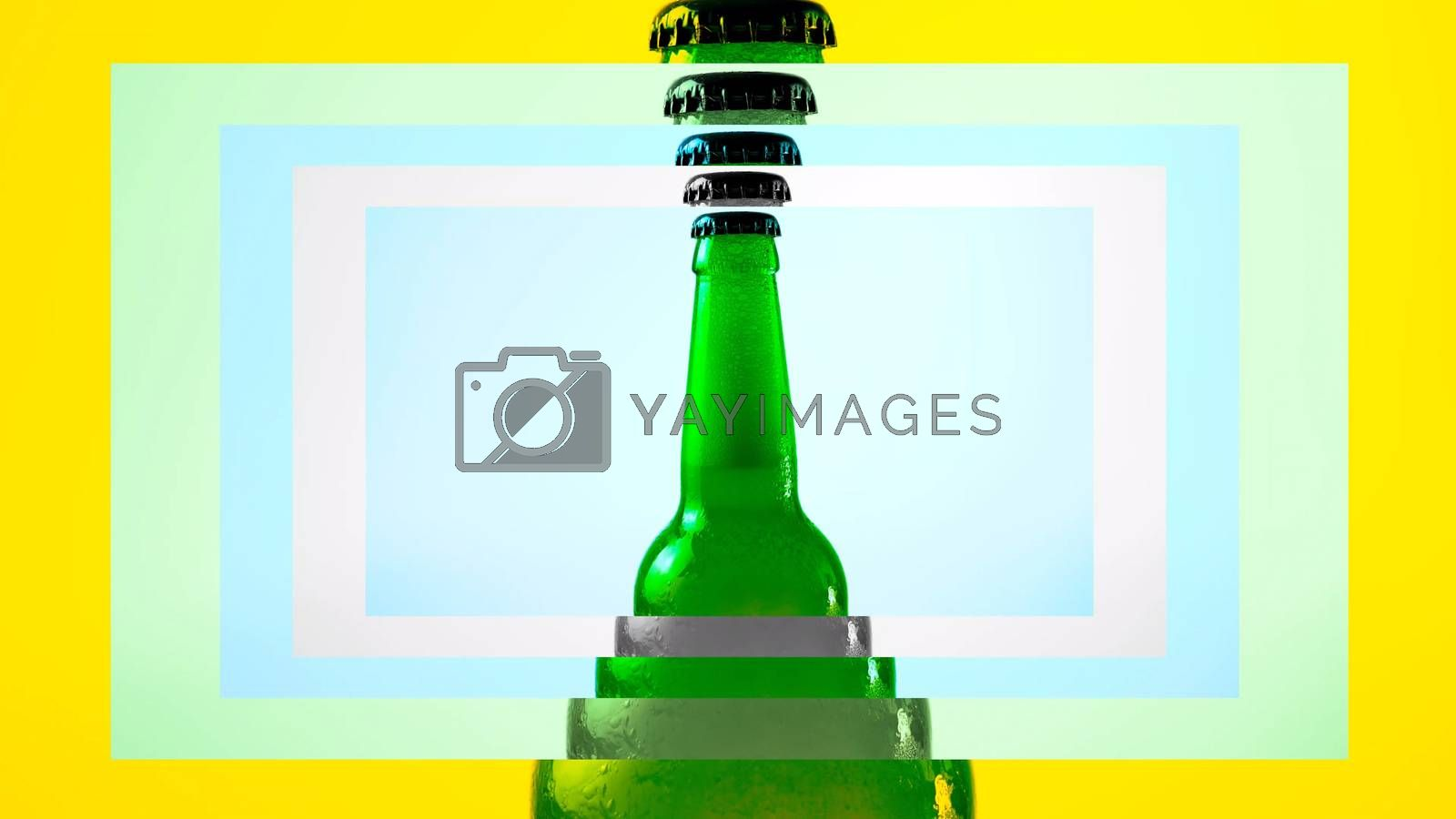 Royalty free image of Light beer in a green bottle in a curly frame with colorful flowers,open a bottle of beer with a effect. by Andriii_Klapkoo