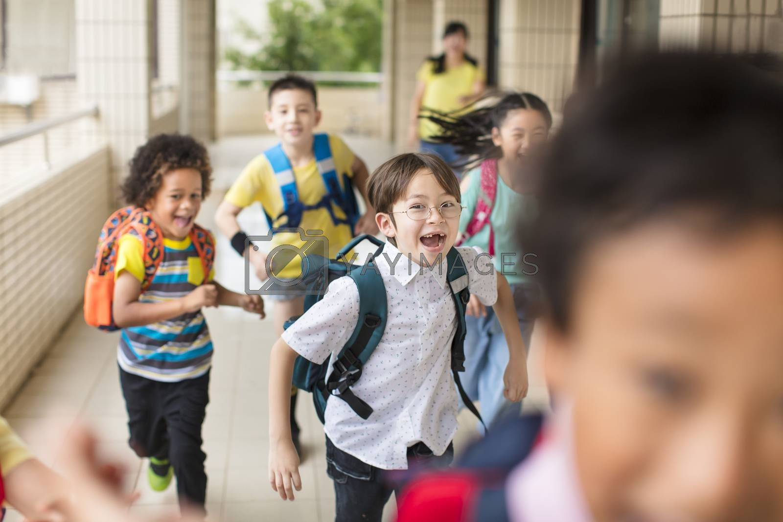 happy Group of elementary school kids running forward by tomwang
