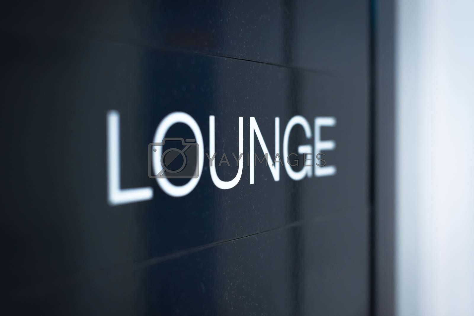 Close up view of black sign with big white inscription Lounge. Having rest or comfortable waiting of flight with good service at airport. Business trips and travelling.