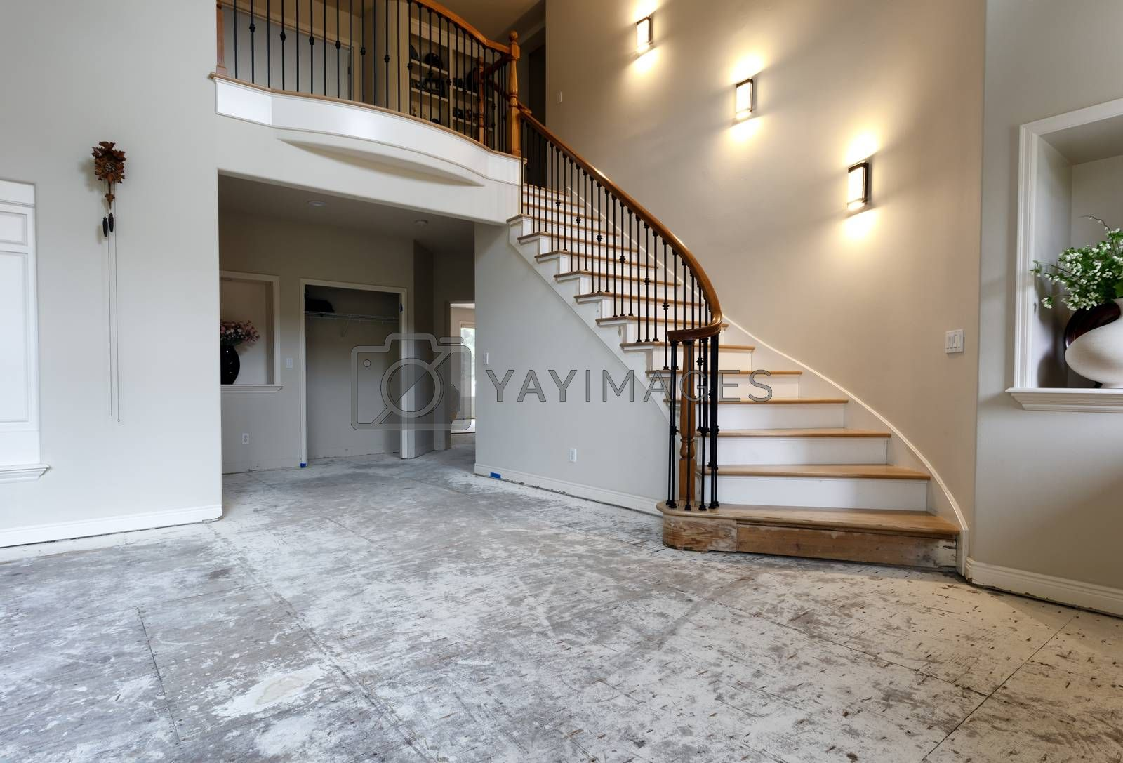 Lights on staircase wall plus floor being remodeled with solid red oak wood