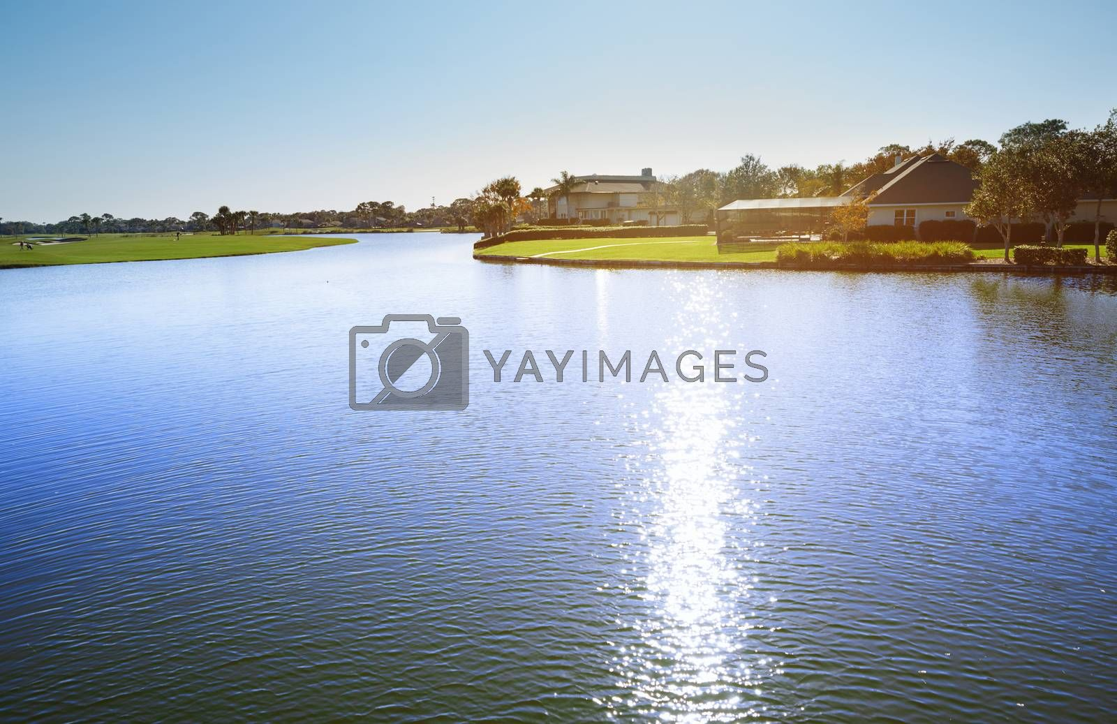 View on suburb district with pond and palm trees. Florida, USA