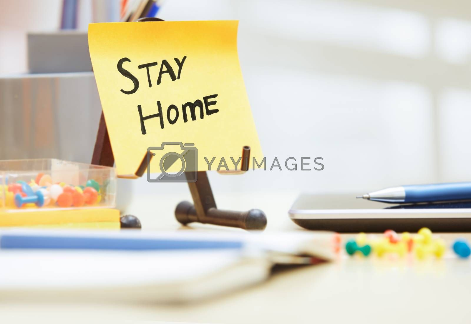Stay Home text on adhesive note at the office
