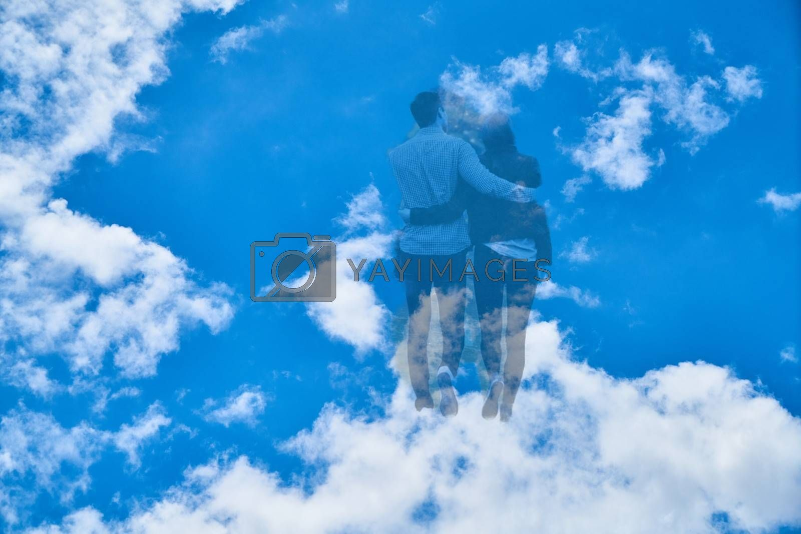 Royalty free image of Couple walks to the heavens through the clouds by balage941