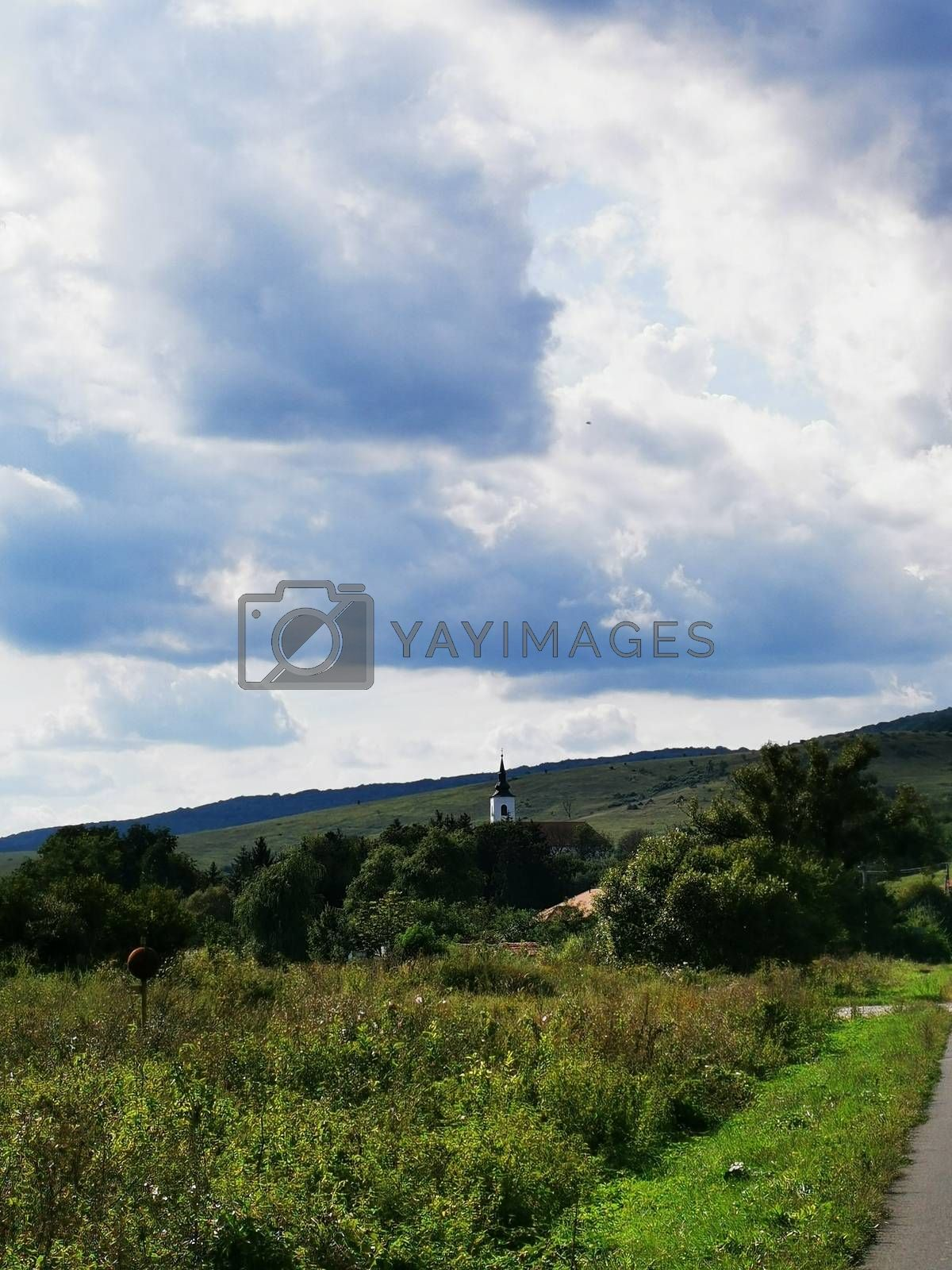 Royalty free image of Near Aggtelek church and overged sky by balage941