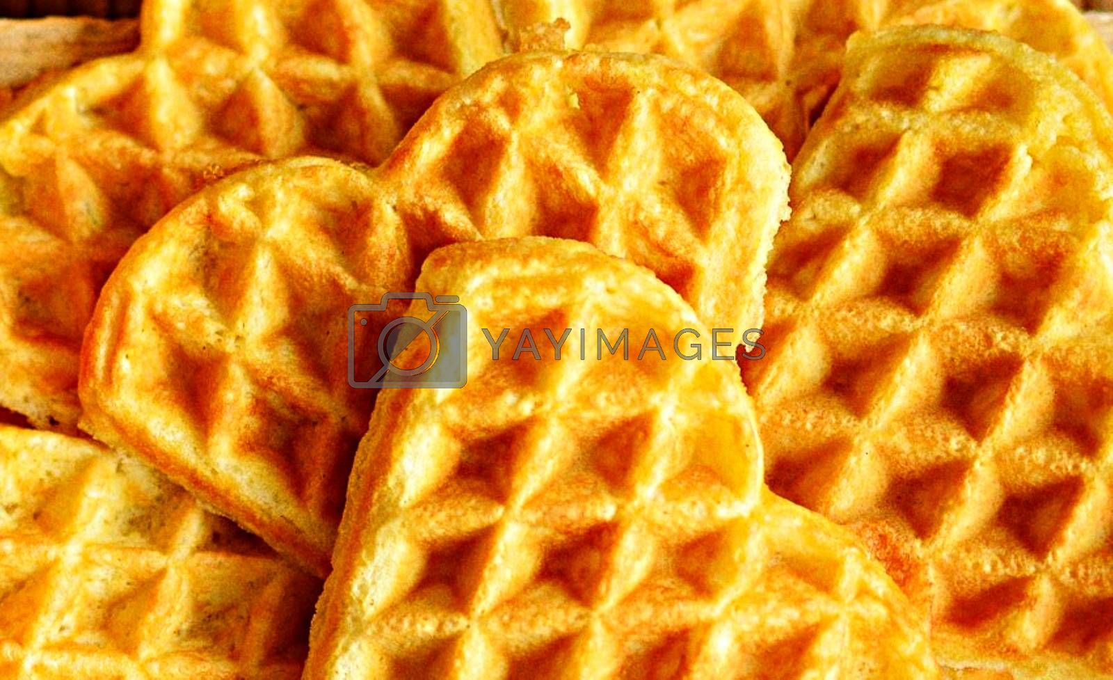 Royalty free image of Closeup shot of delicious heart-shaped waffles by balage941