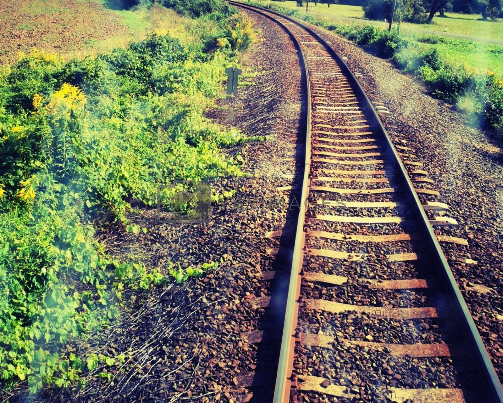Royalty free image of Train track skyline and green field photographed from the train by balage941