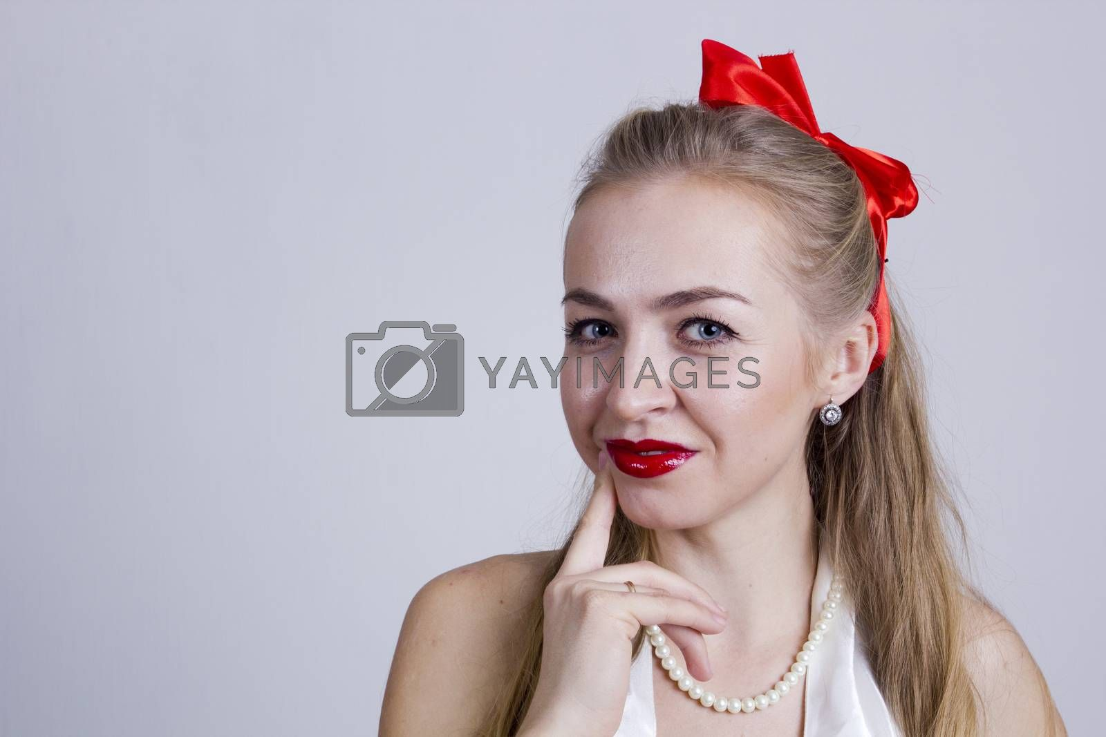 Portrait of a young beautiful woman on a white background
