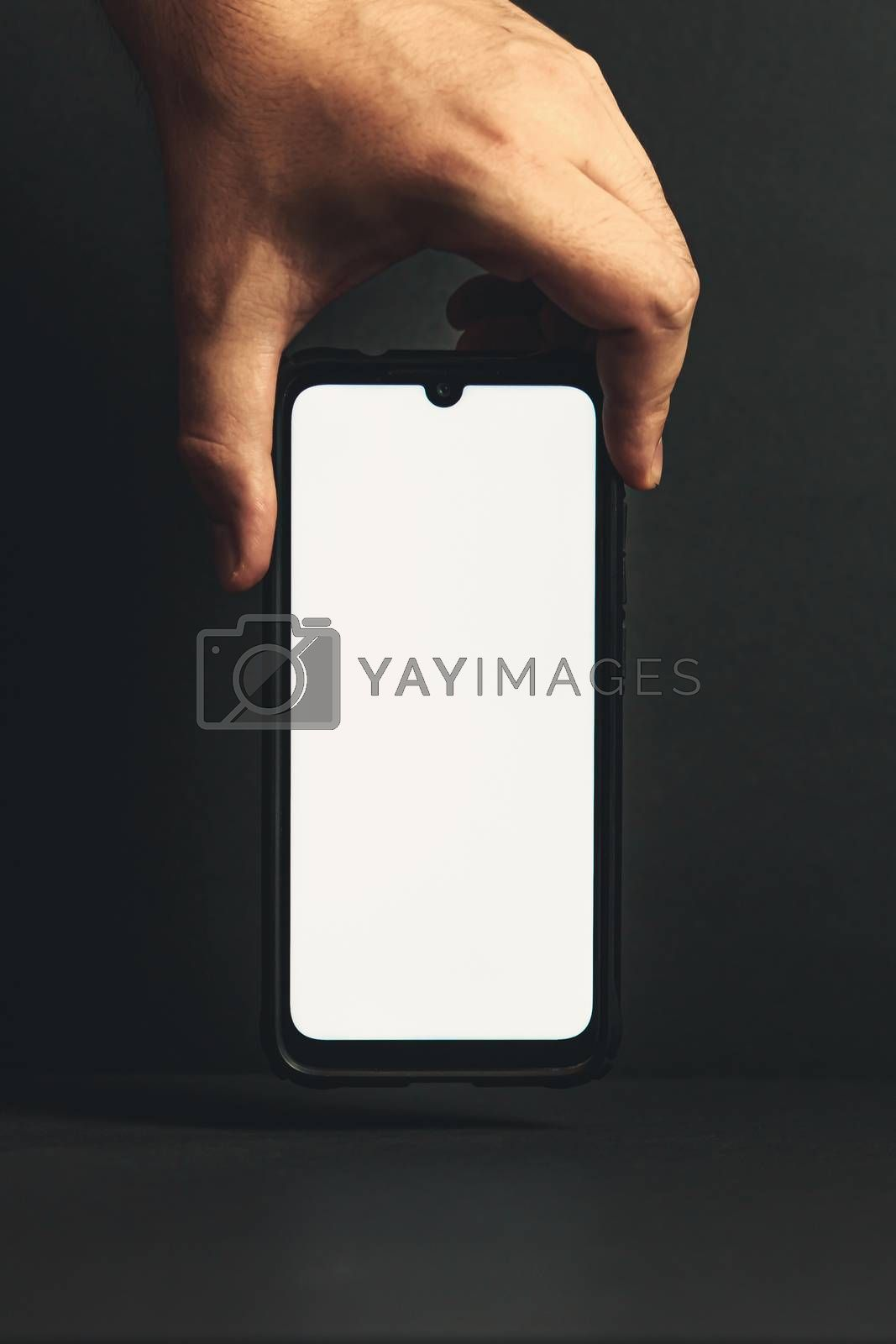 Hand grabbing a phone with copy space