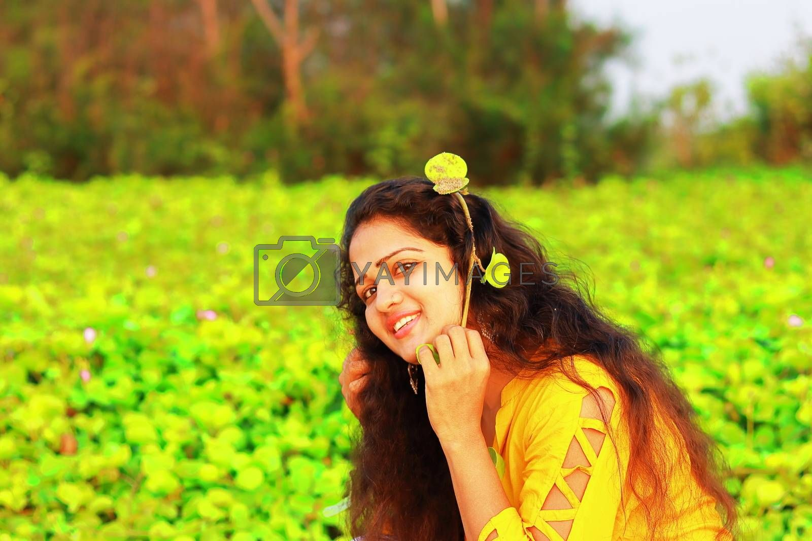a stylish indian girl with blur green background, asian people