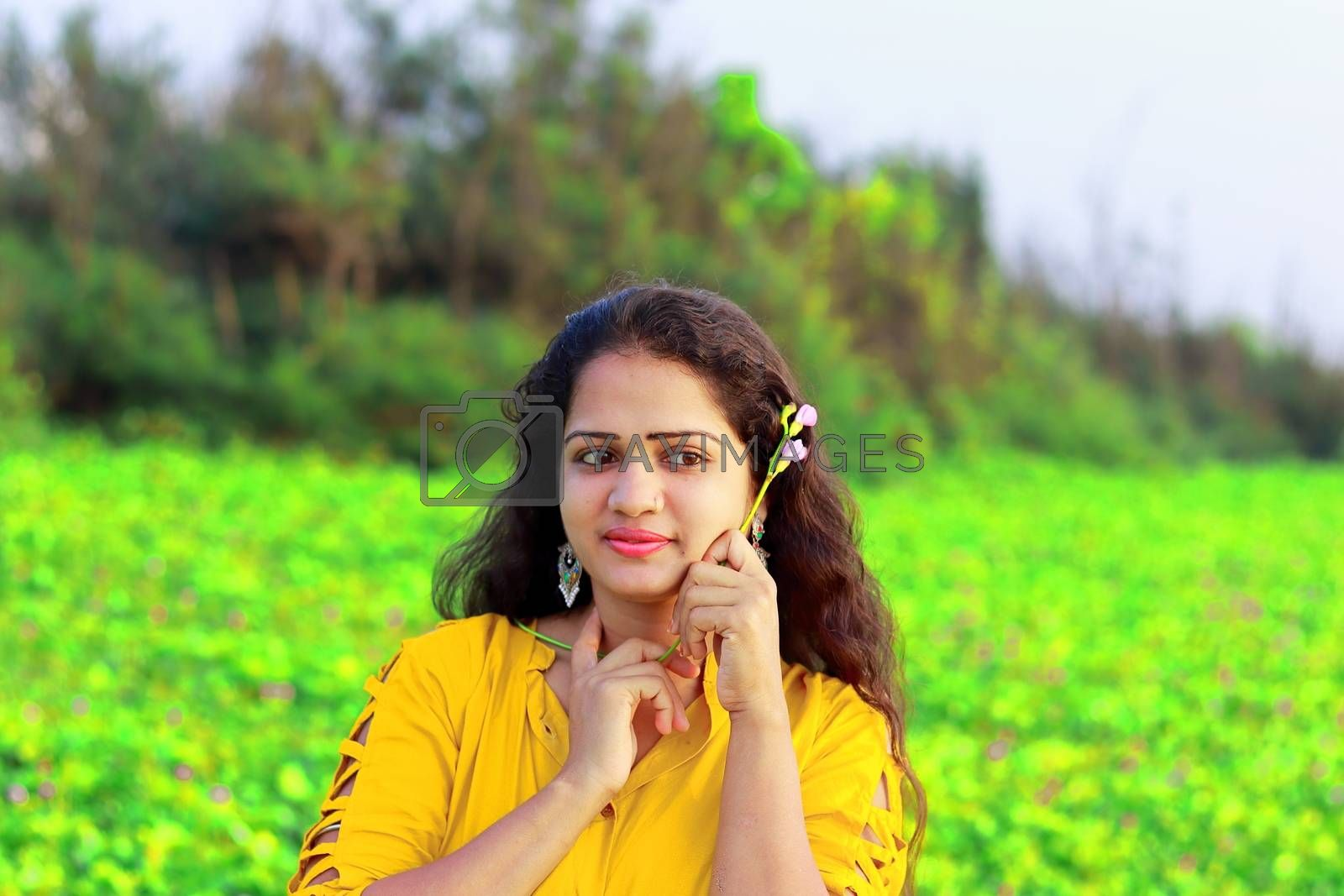 nature lover, a stylish fair girl with blur green background