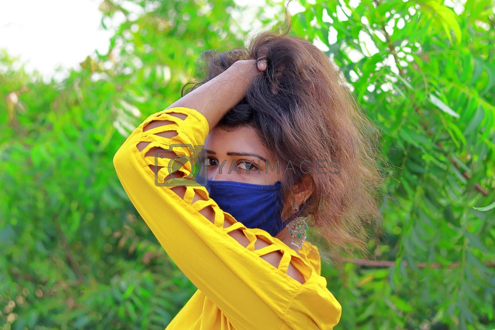 Fashionable portrait of a indian girl model with wearing face mask Protection against disease, coronavirus.