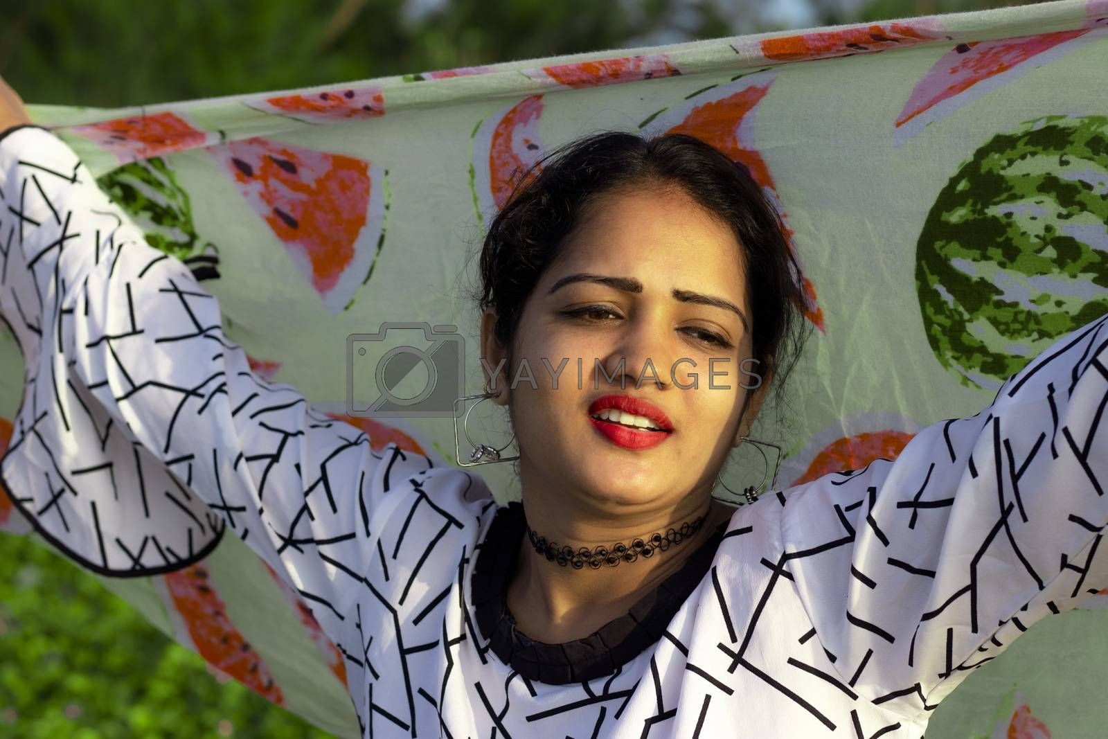 Fashionable portrait of an indian girl model with Colorful scarf waving from top of head