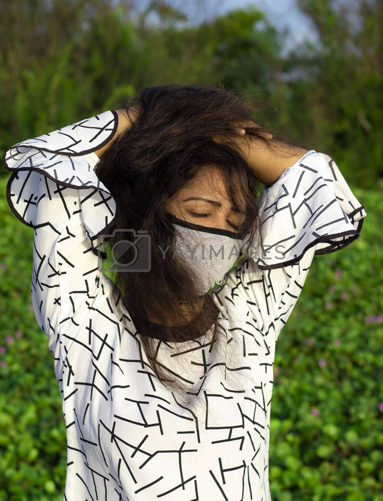 Portrait of a stylish young girl in a medical brown mask. Protection against contagious disease, coronavirus, covid-19.
