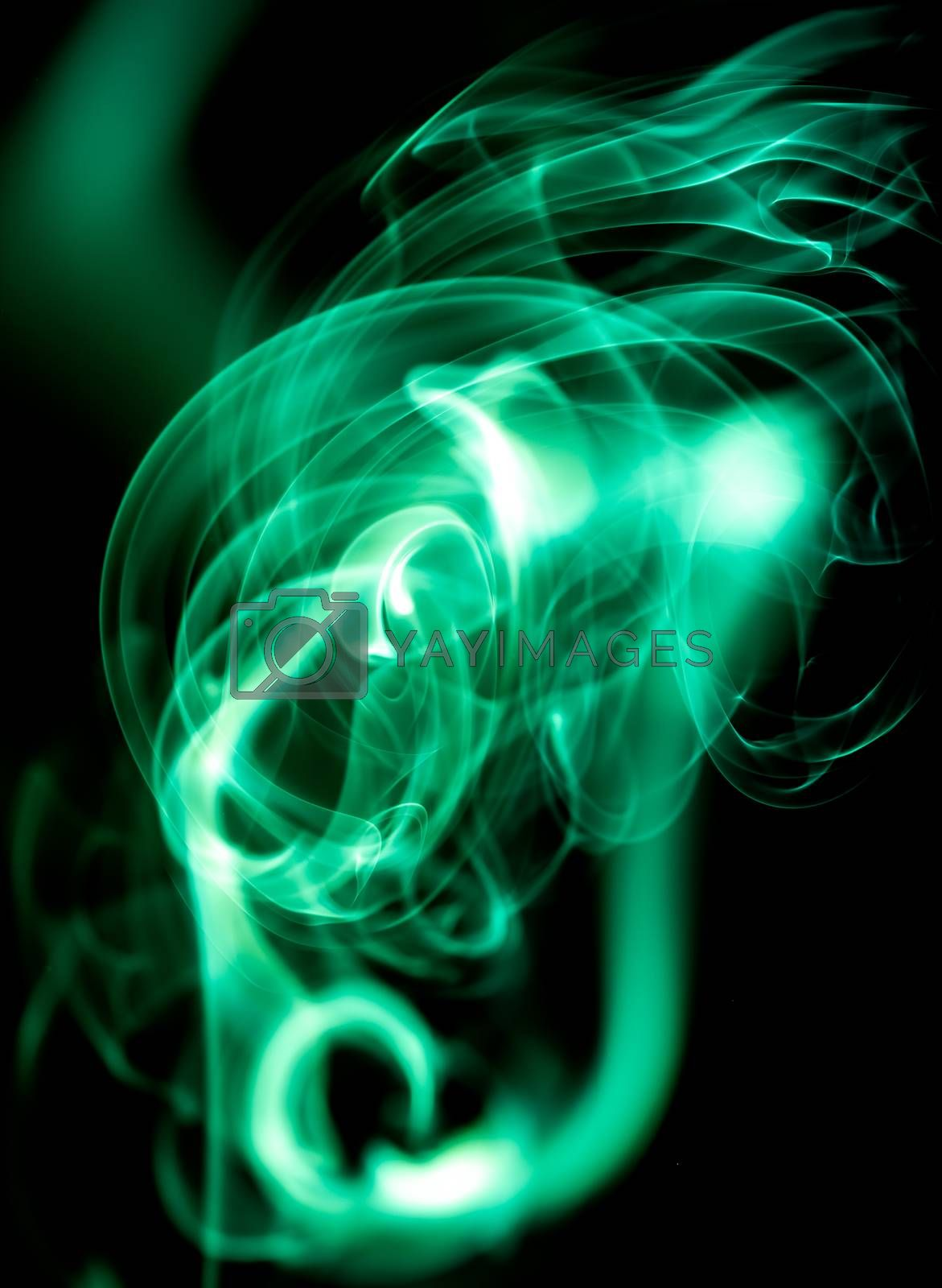 Red abstract shaped smoke against black background. Abstract background. Selective focus
