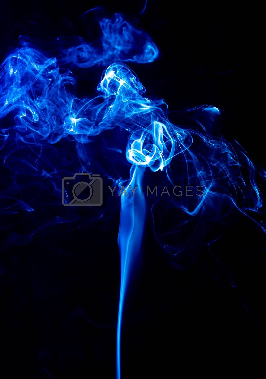 Blue abstract shaped smoke against black background. Abstract background. Selective focus