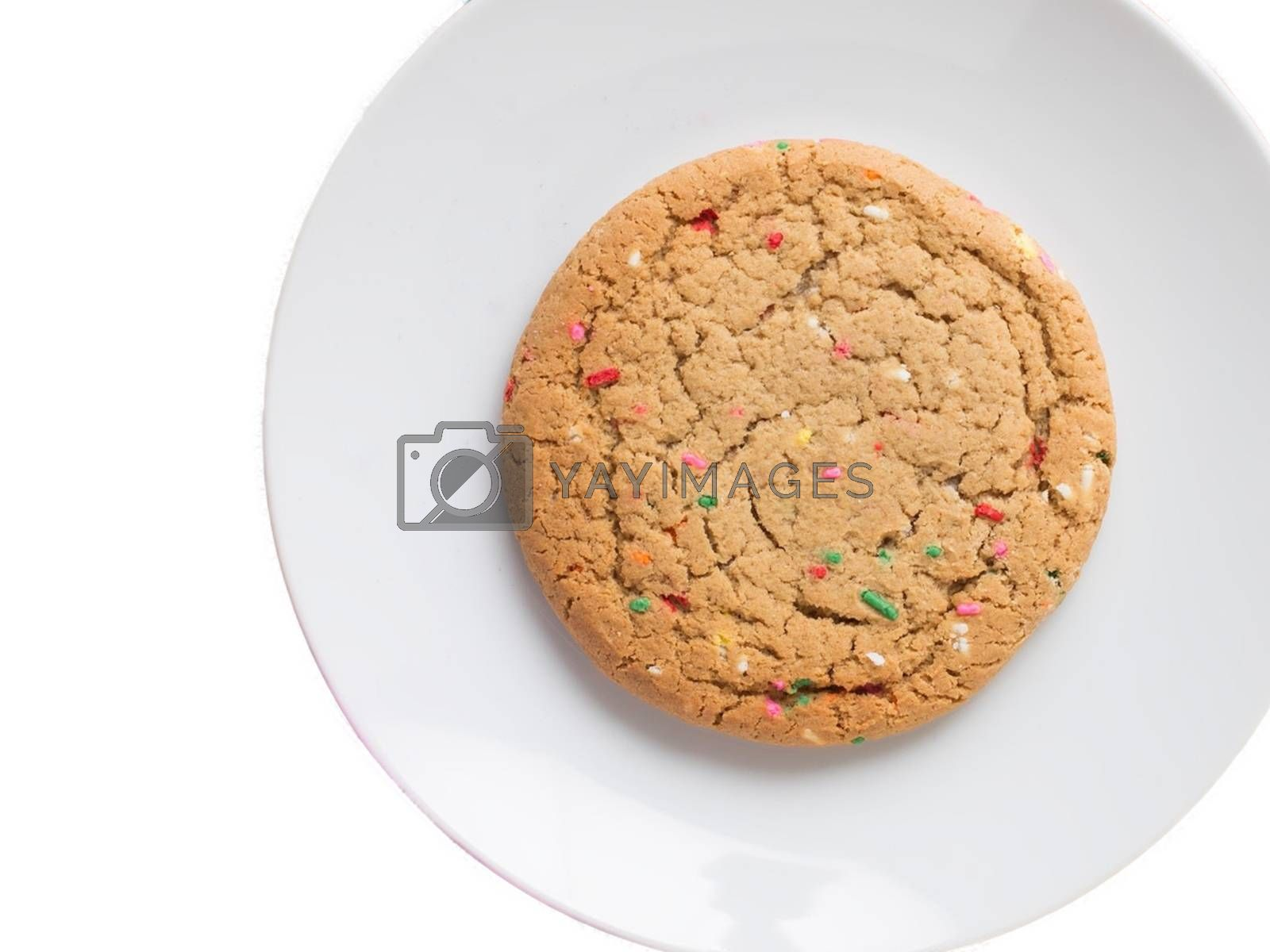 Royalty free image of Almond giant biscuits with coloured sugar pieces on a white platter by balage941