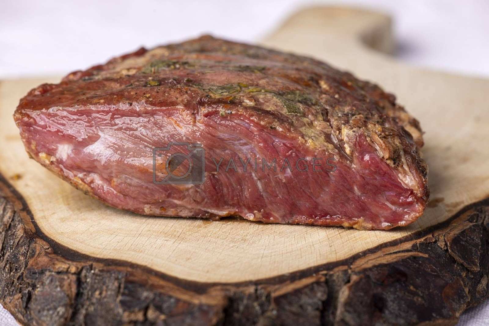 pastrami meat on a wooden chopping board