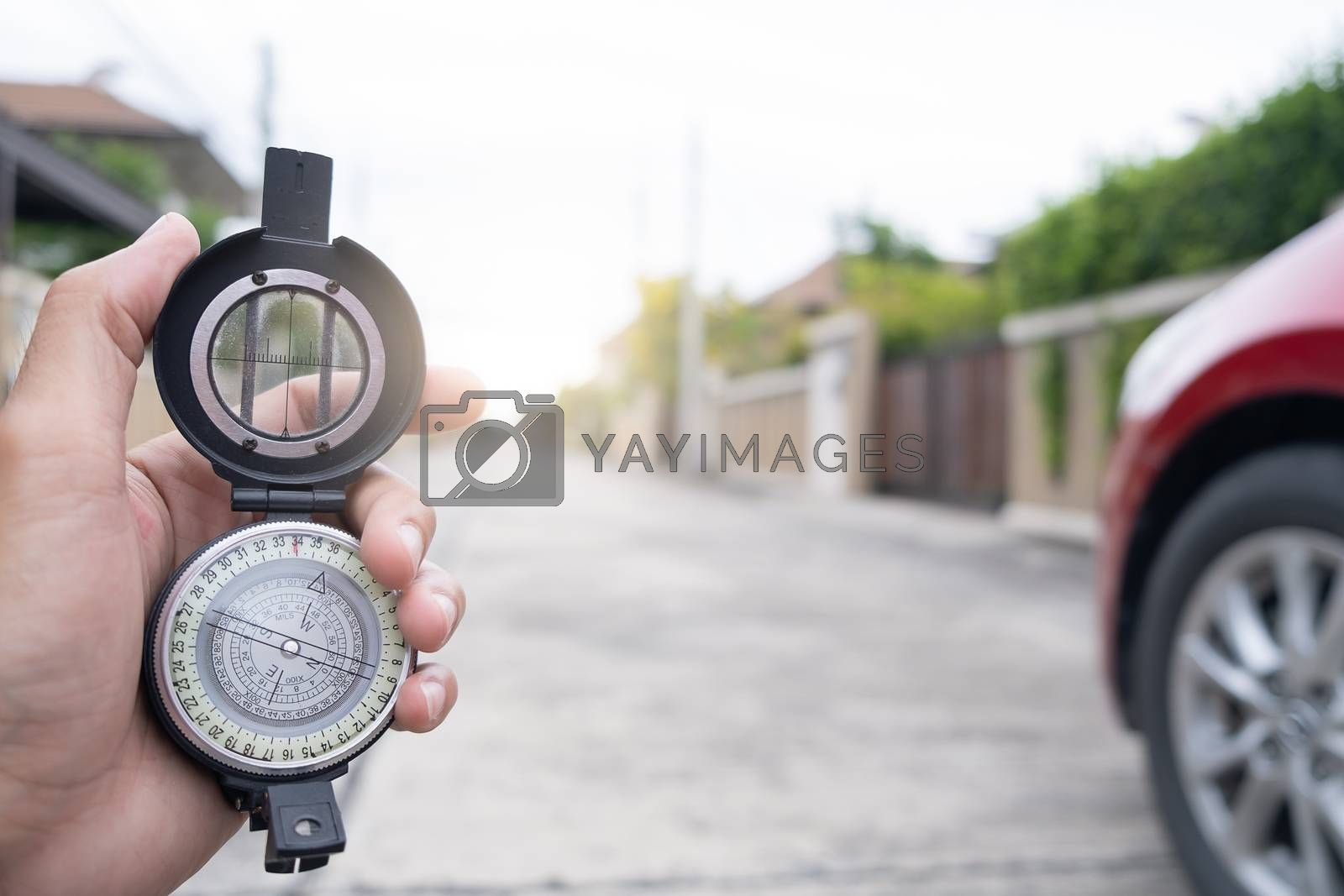 man holding compass on blurred background. for activity lifestyl by oatzpenzstudio