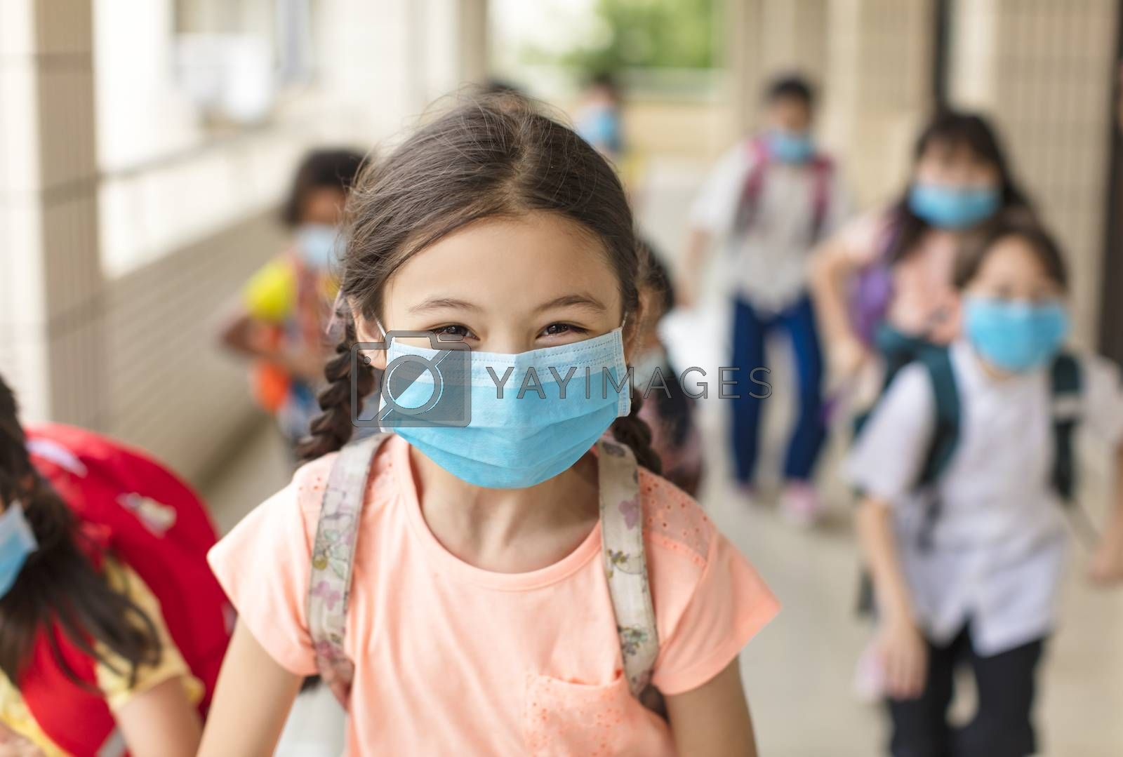 children wearing  face medical mask back to school after covid-19 quarantine by tomwang