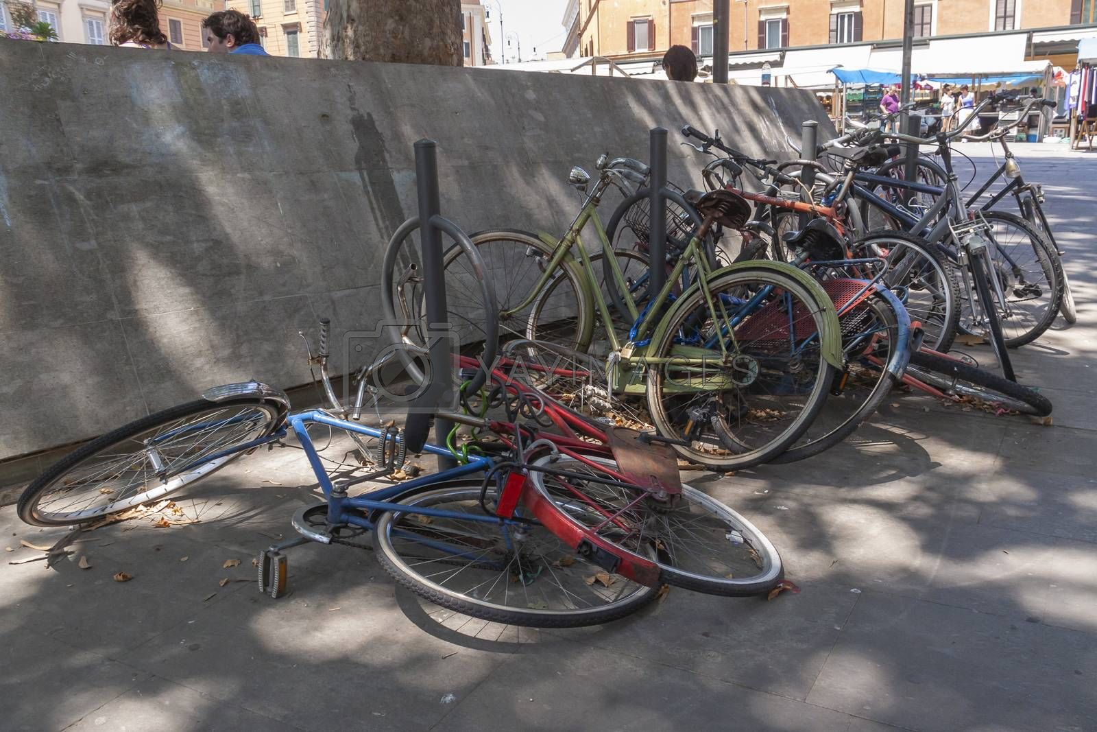 Rome, Italy - June 28, 2010: A lot of bicycles, old, some broken, remain abandoned and rusting in a street in Rome.