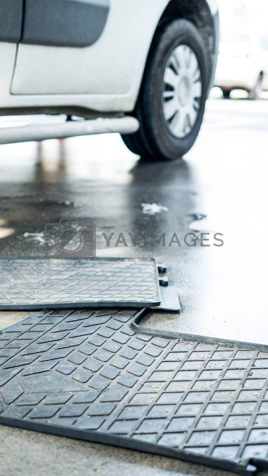 Royalty free image of Washing of car mats,preparation for cleaning rubber car mats. by Andriii_Klapkoo