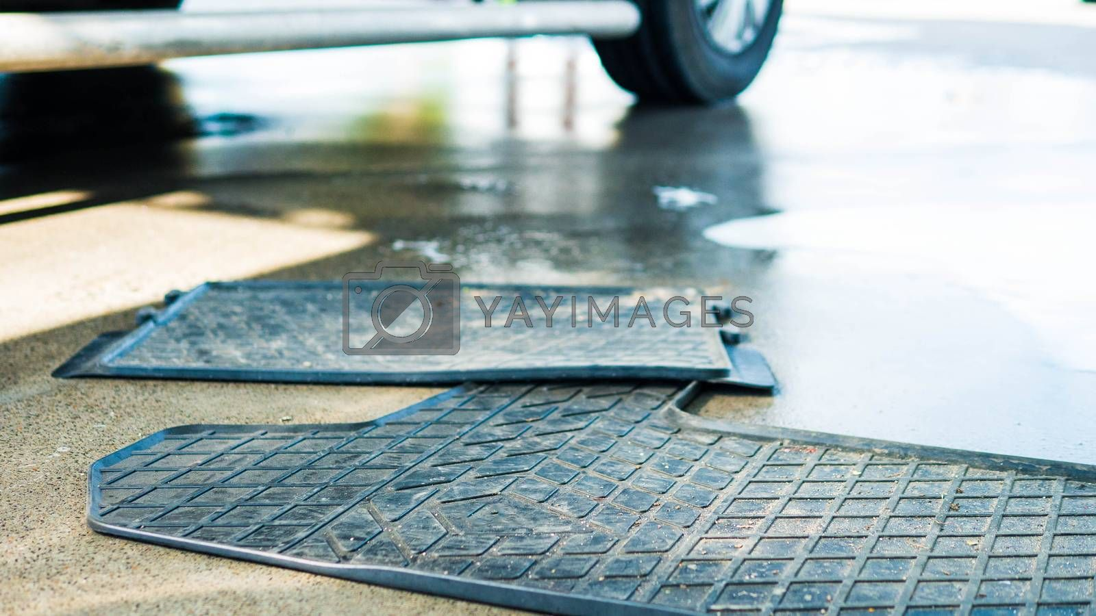 Royalty free image of Dirty car rubber floor mat,close-up. by Andriii_Klapkoo